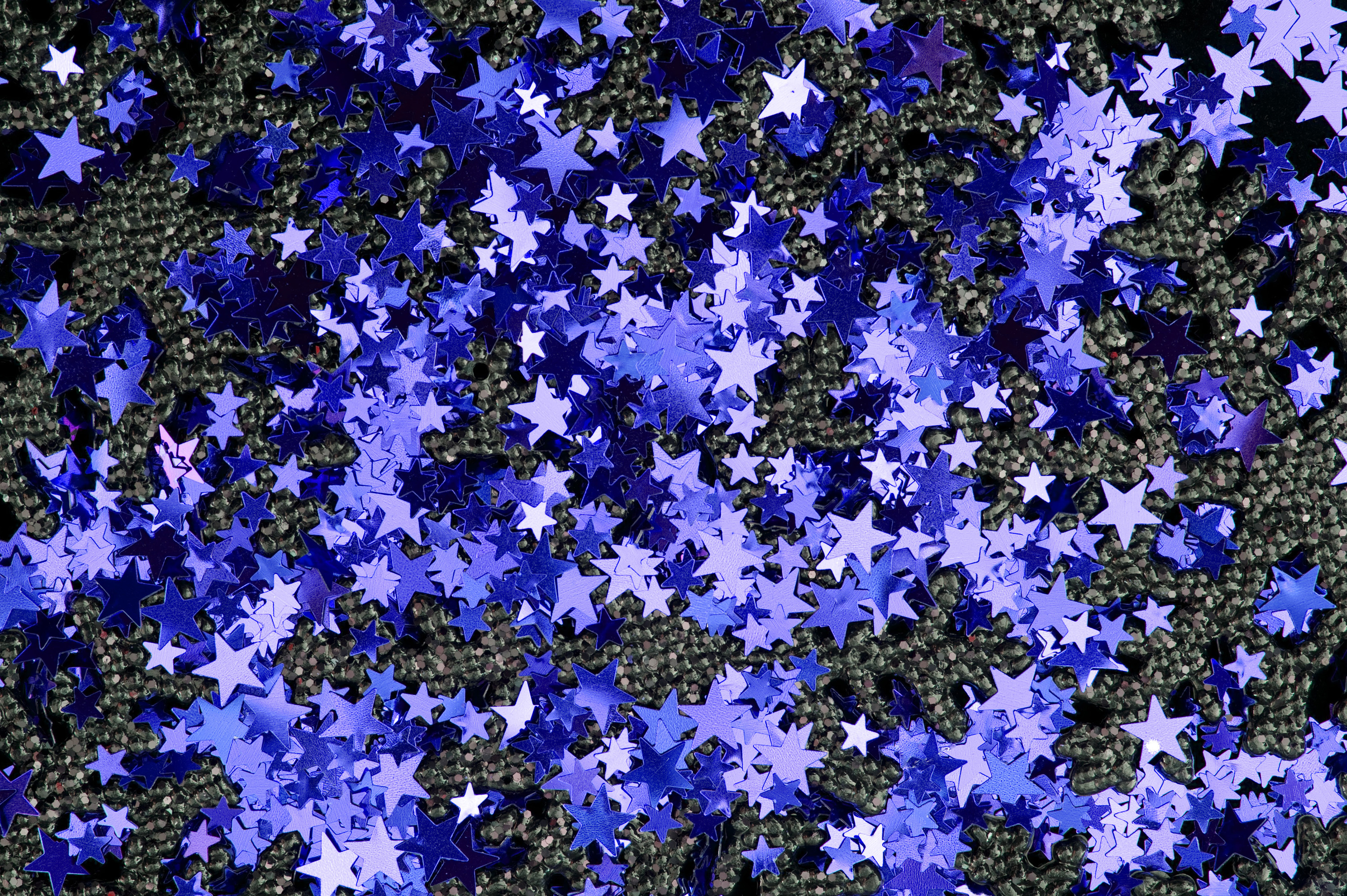 a background of blue metallic star shapes