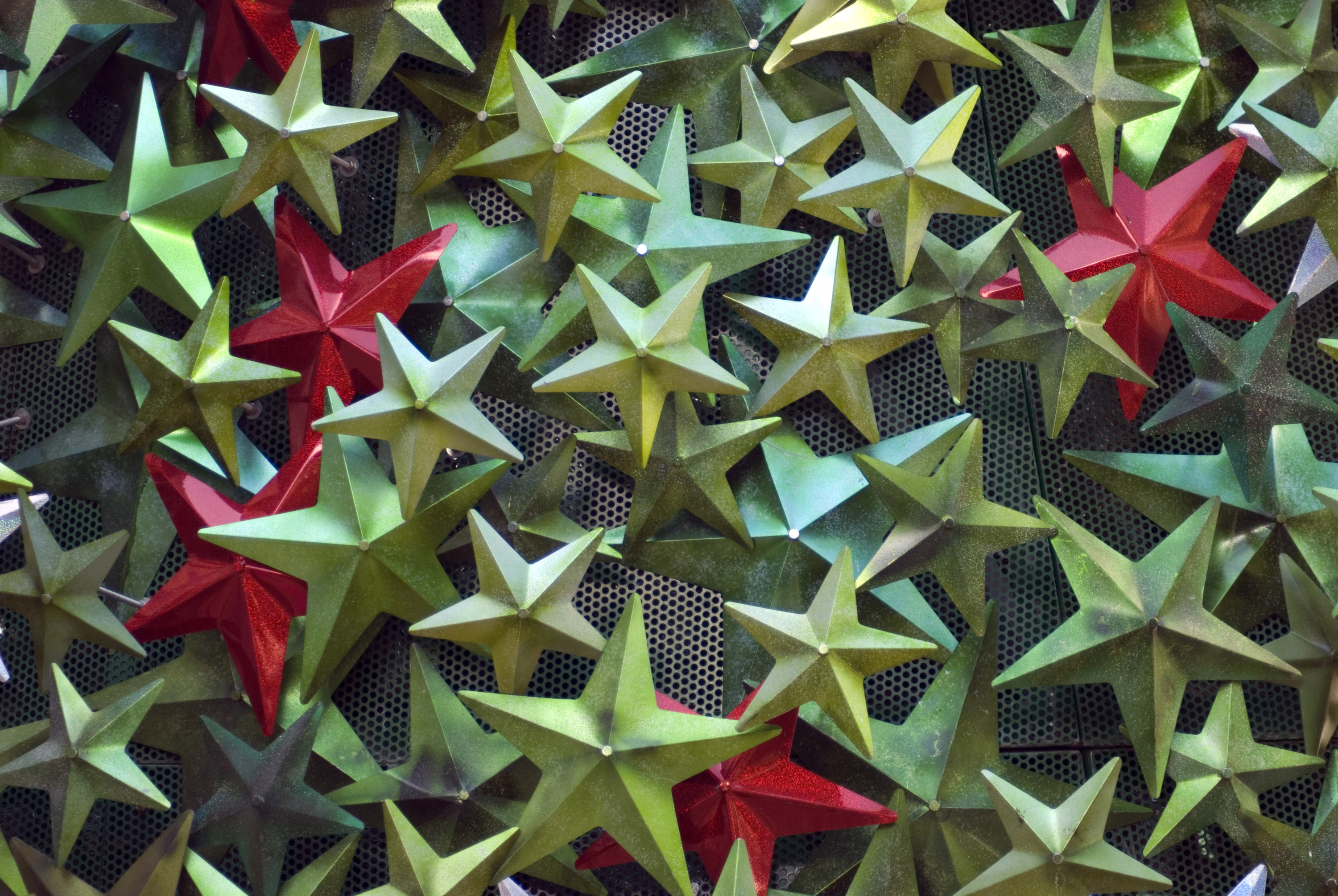 an assortment of festive star shaped decorations in metallic green and red