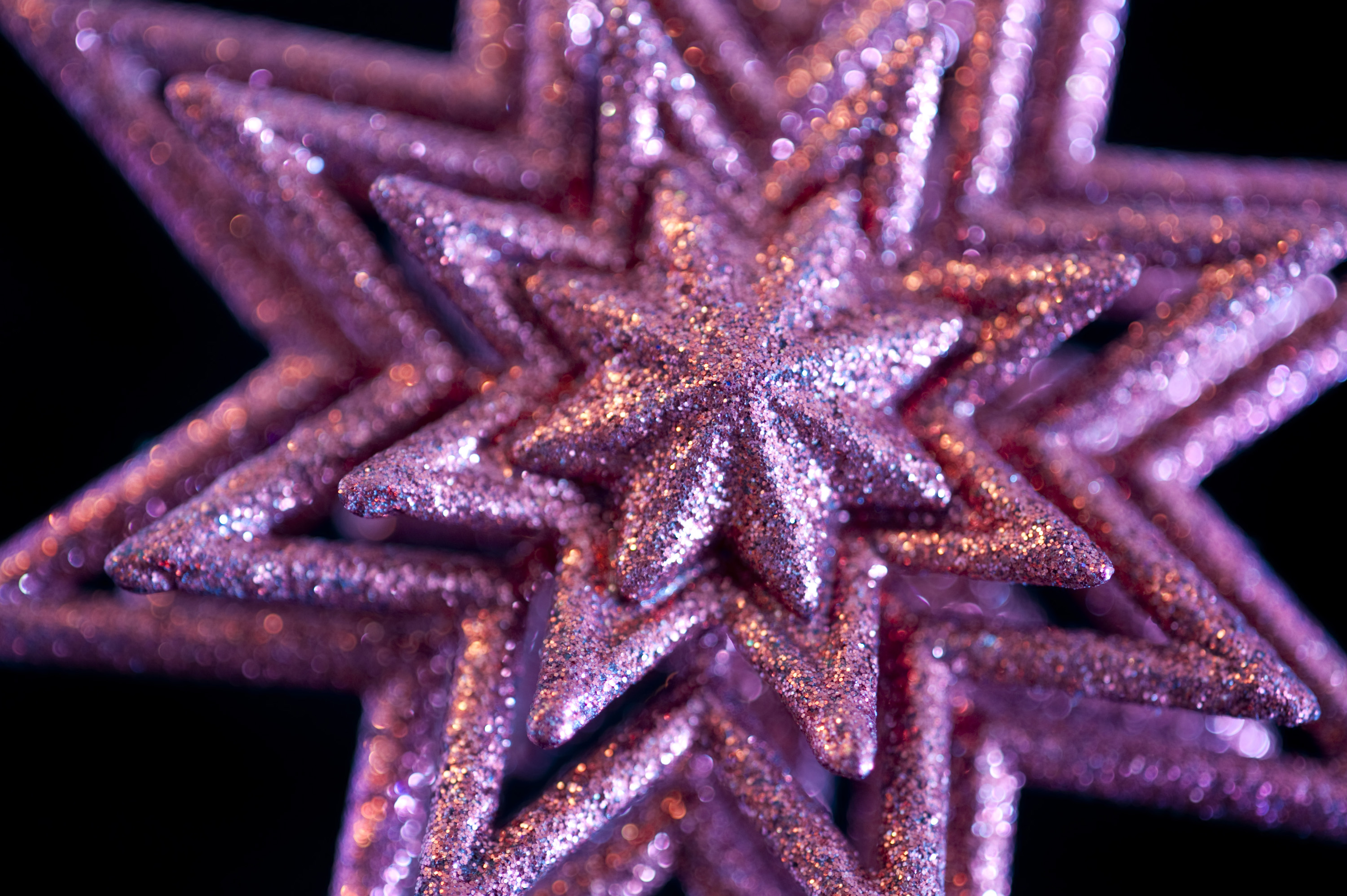 a glittery pink christmas star tree decoration