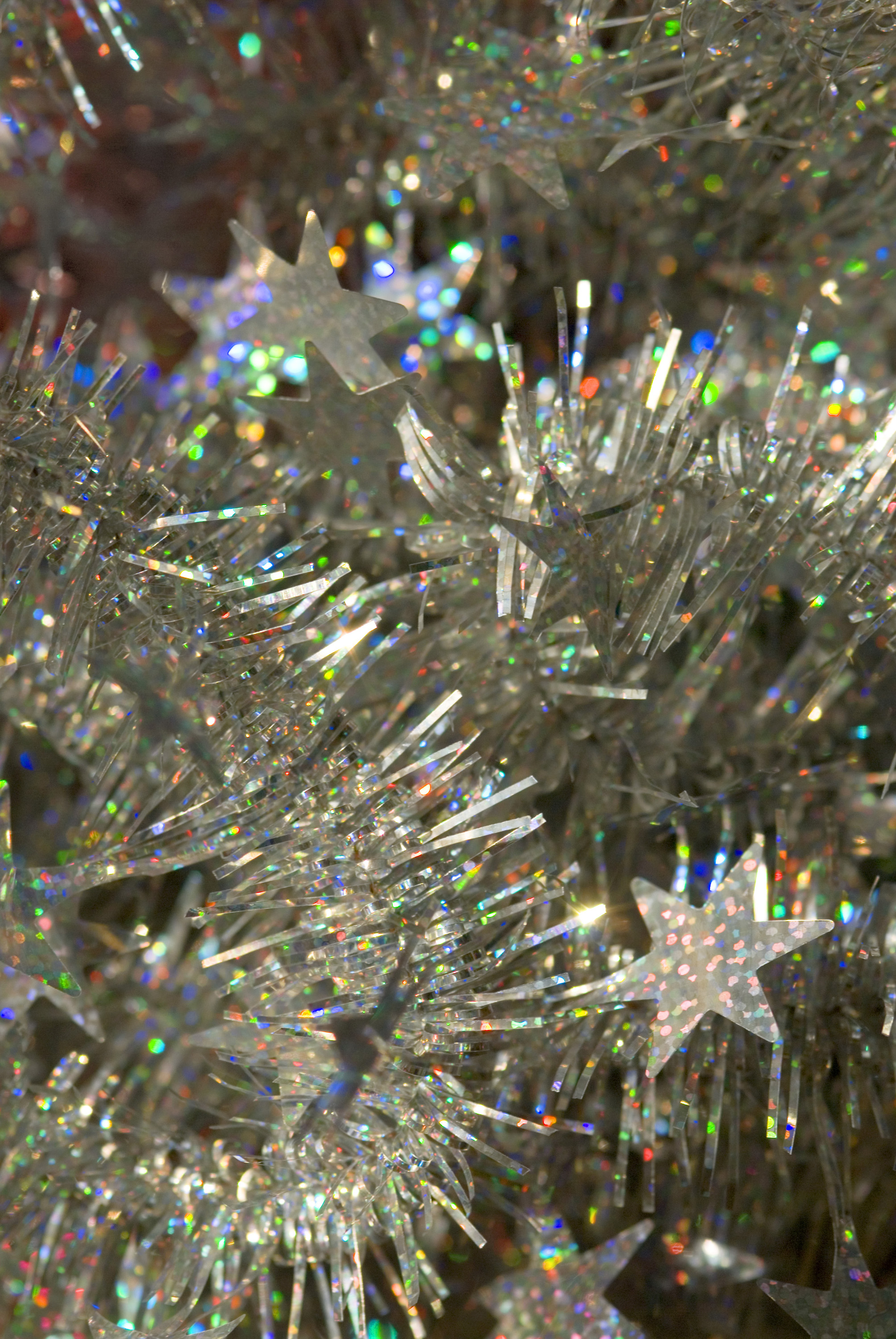 a festive silver and multicolour sparkling background of tinsel