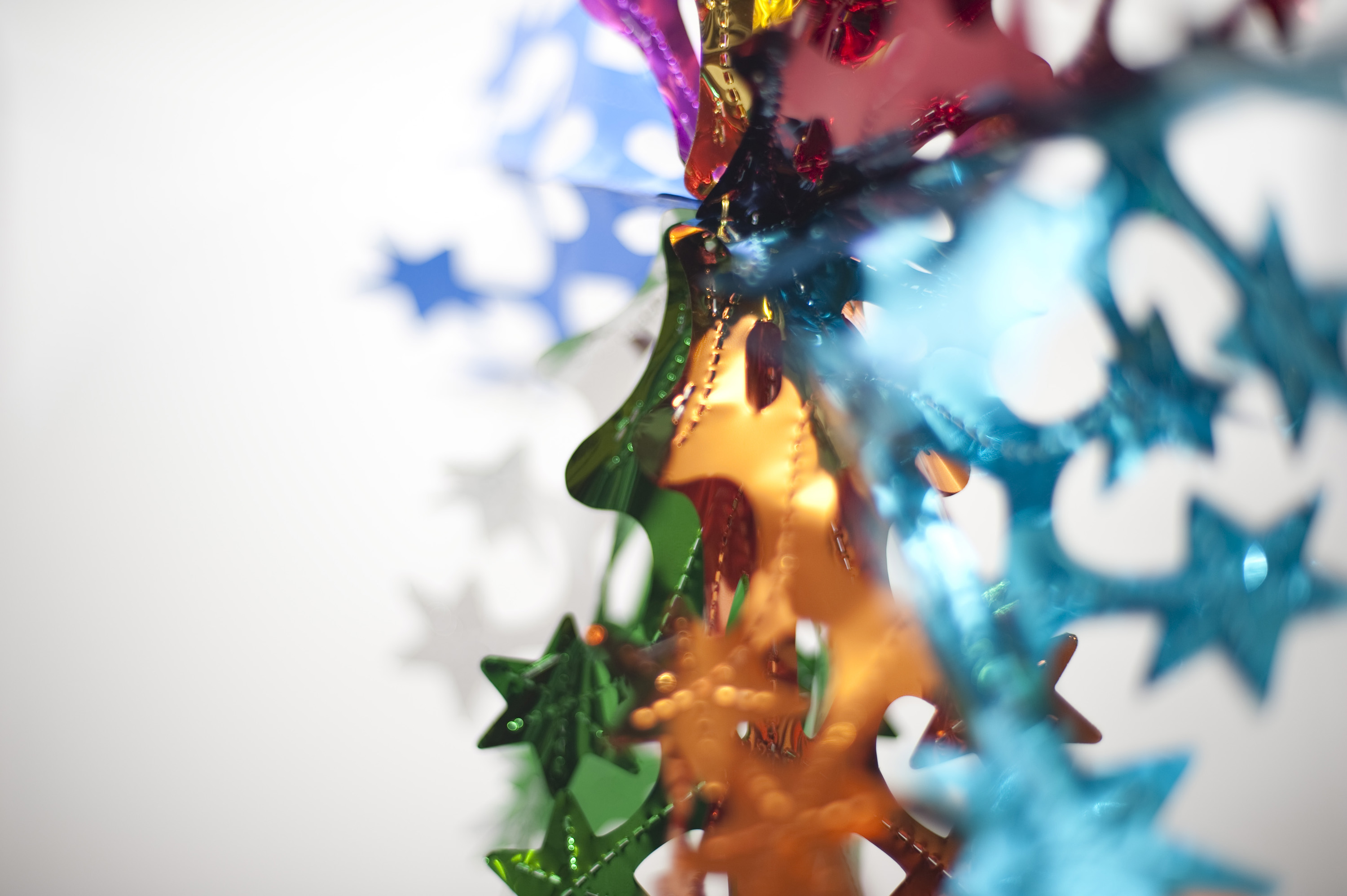 a colorful abstract image of a christmas foil decoration on a white background