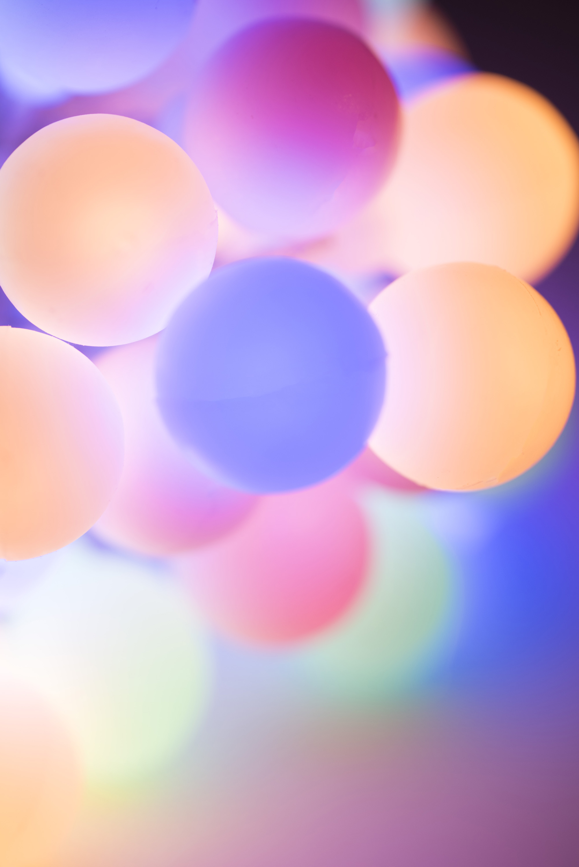 Christmas background of circular pastel colored lights in a soft blur of shallow dof focus and copy space for your seasonal greeting