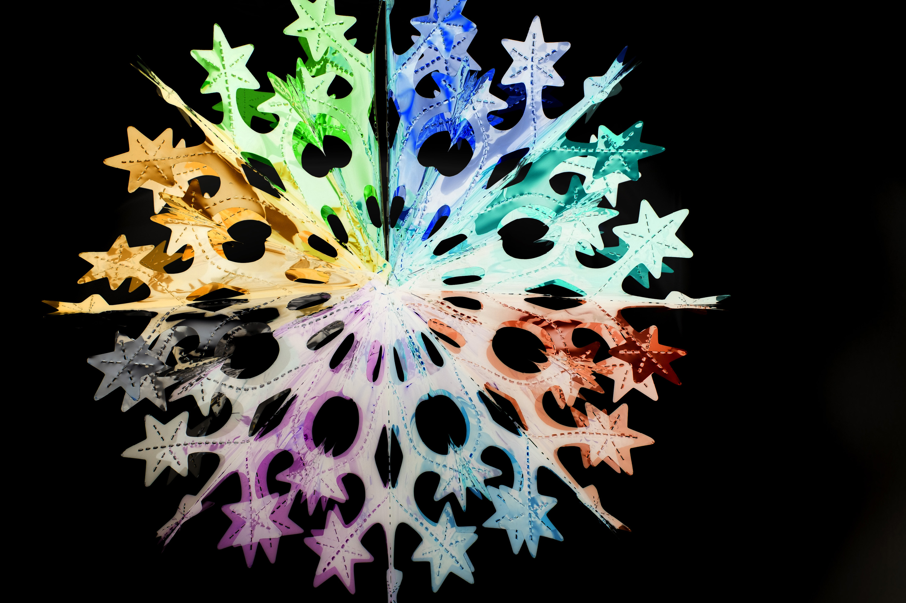 an abstract image of a coloful christmas star decoration
