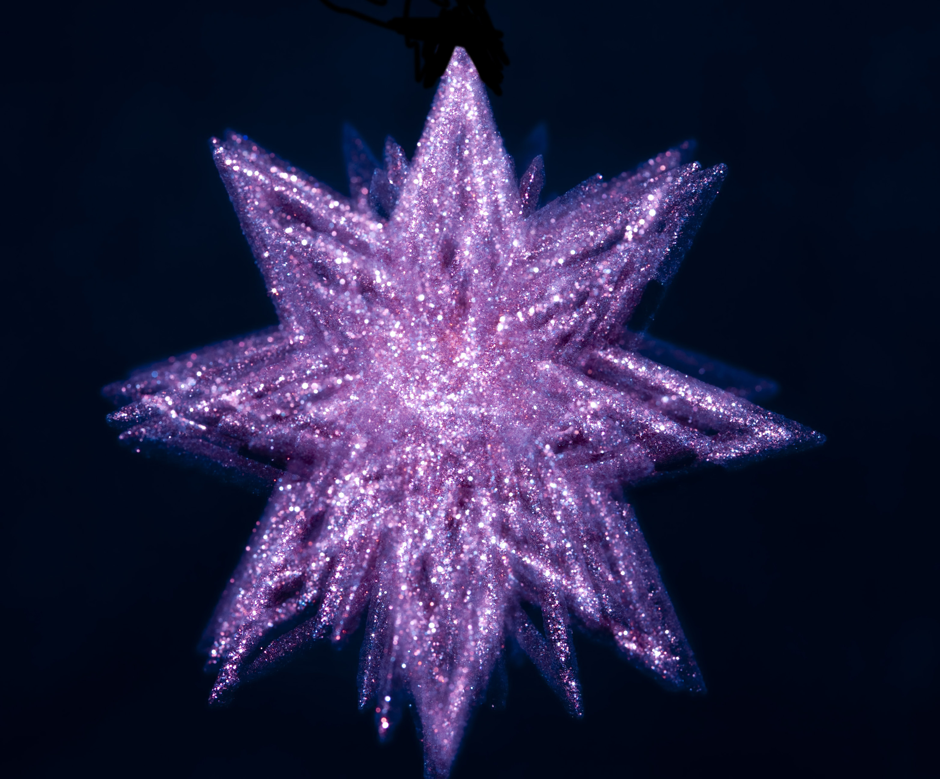a glittery christmas star decoration with spinning motion effect
