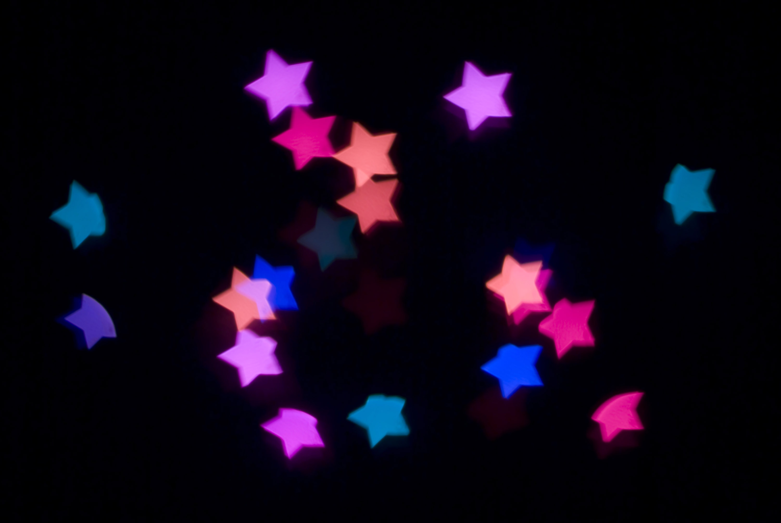 a backdrop of glowing lens bokeh star shapes