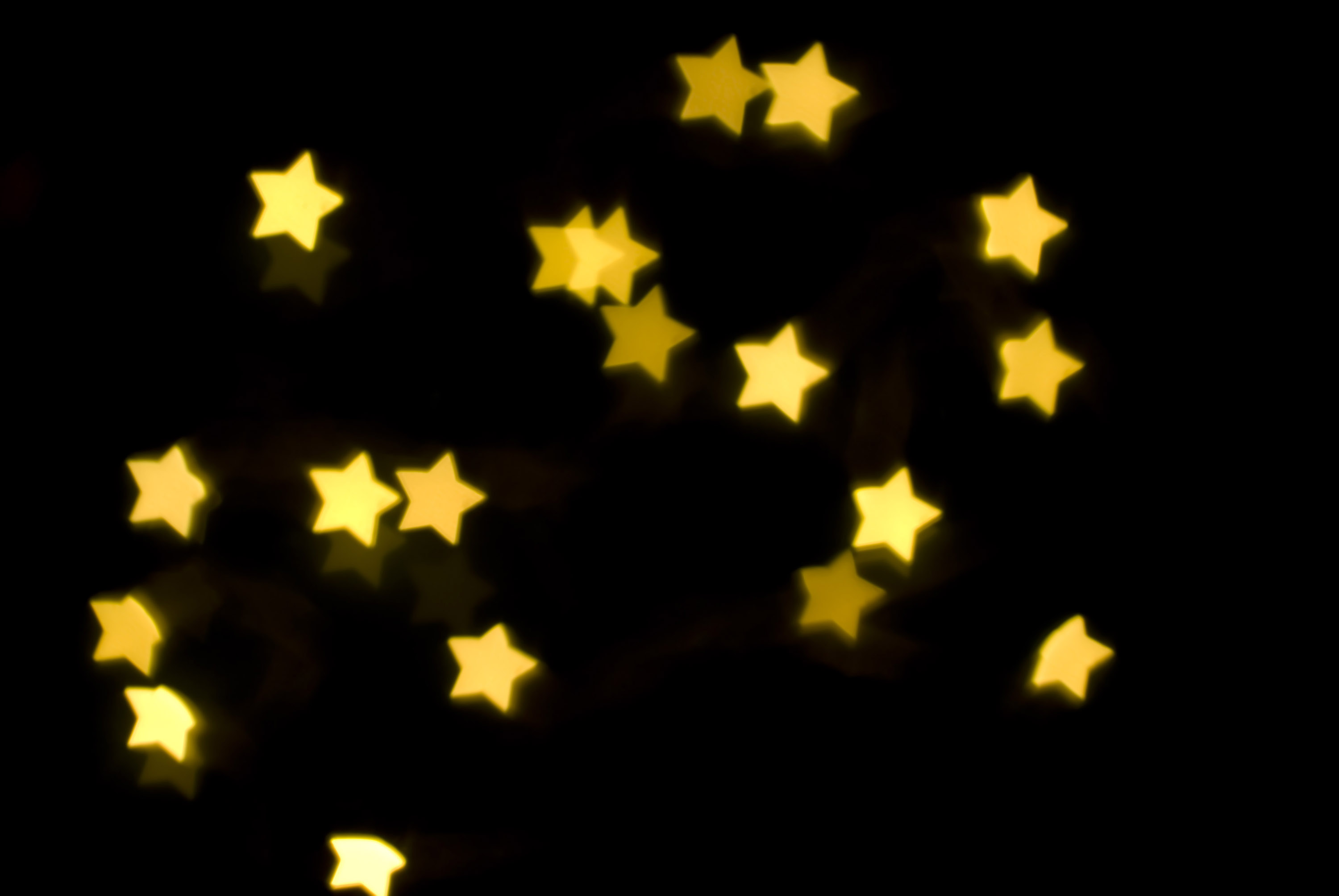 background of glowing yellow star shapes