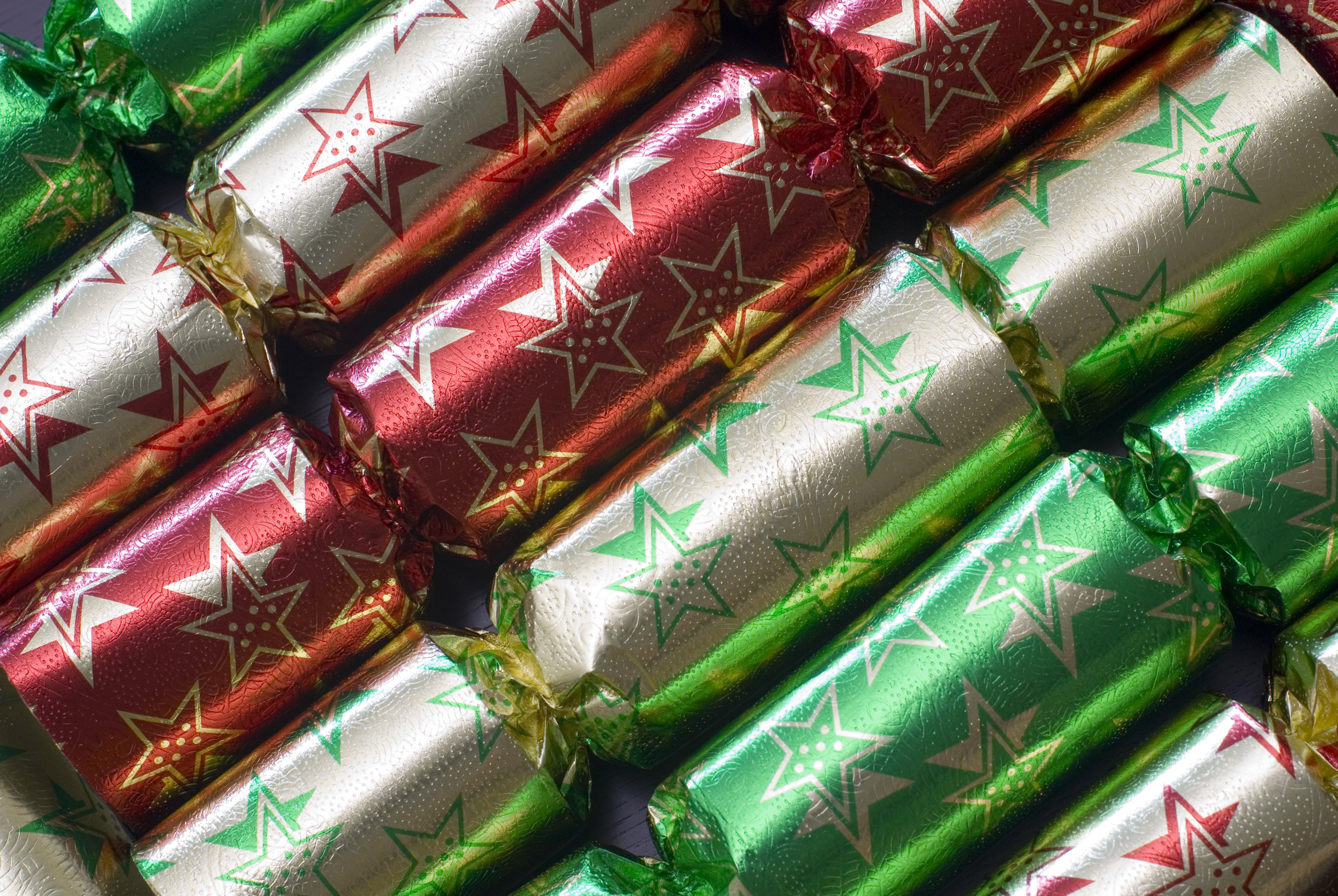 a row of colourful christmas crackers