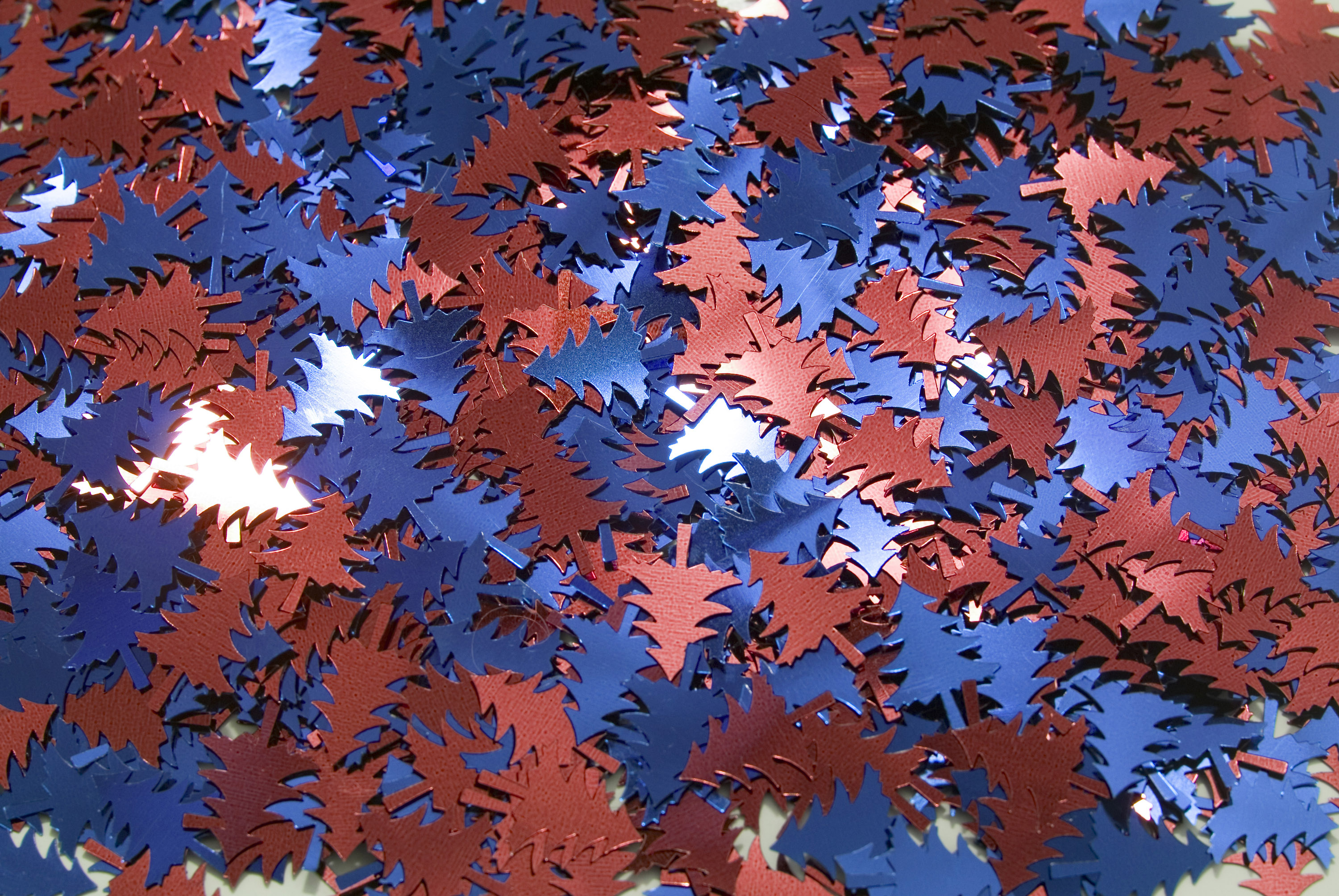 hundreds of metallic christmas tree shapes in red and blue