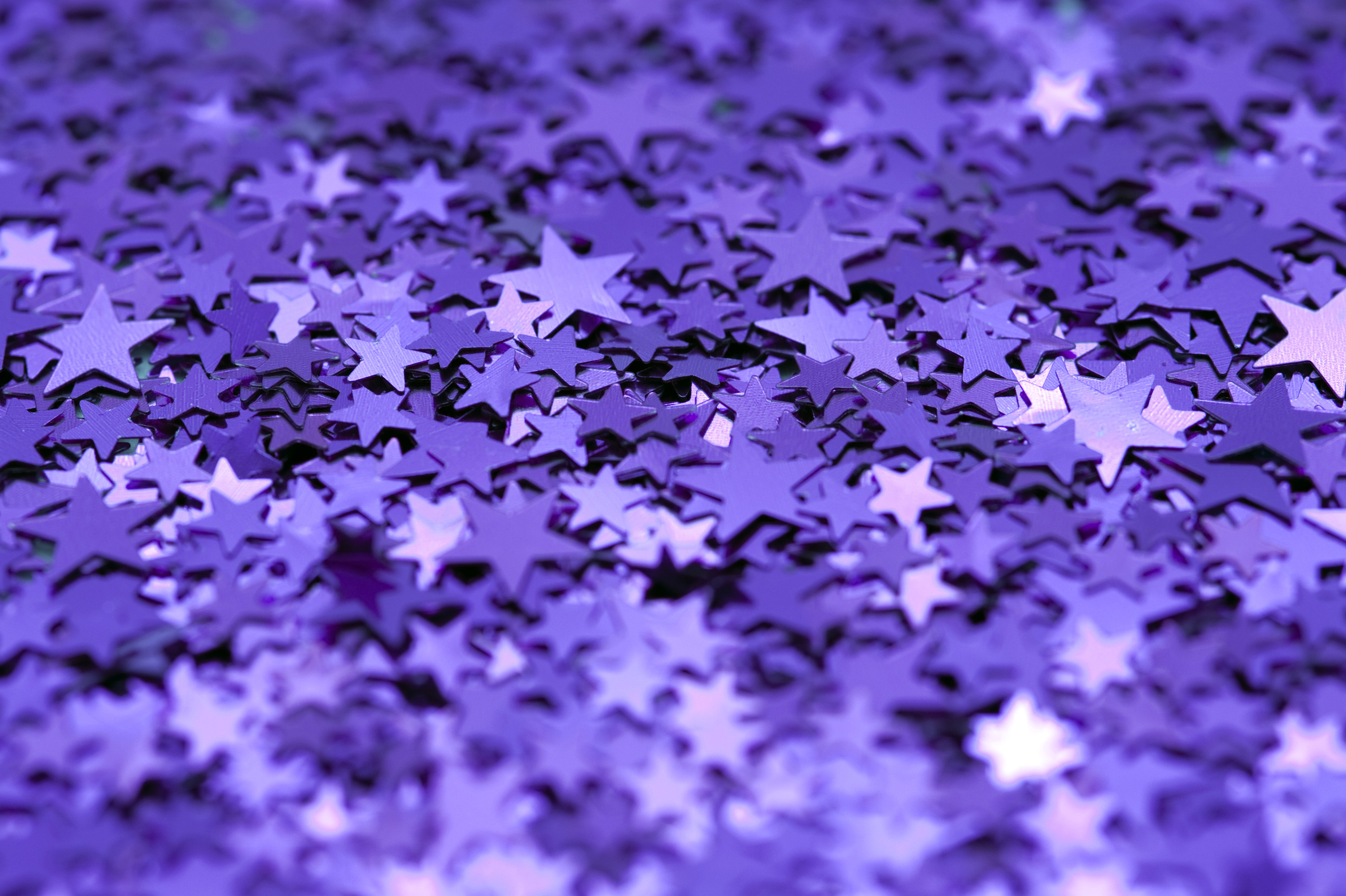 a colorful background of sparkling purple stars