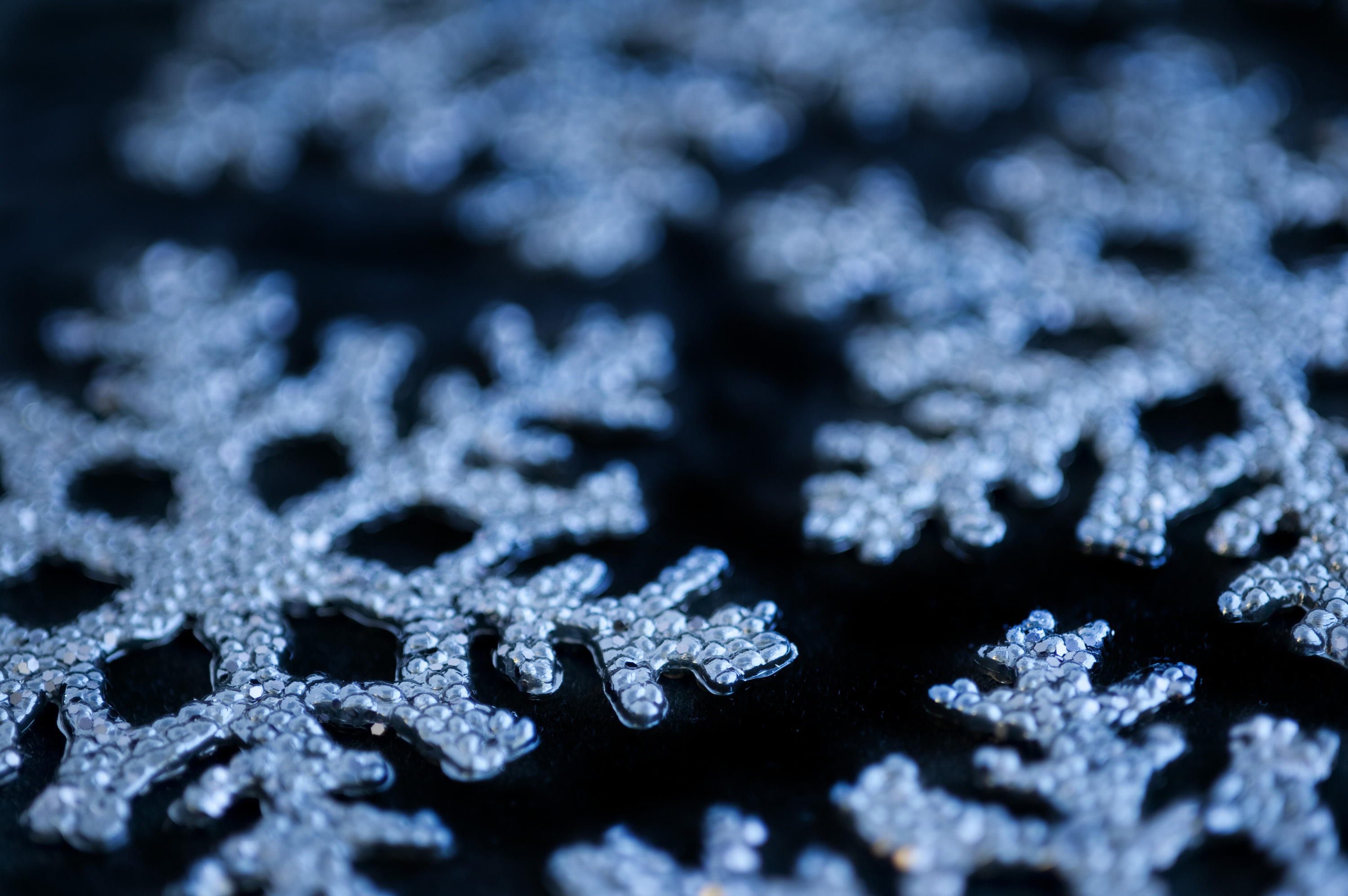 a background photo of christmas snowflake decoration on a black background