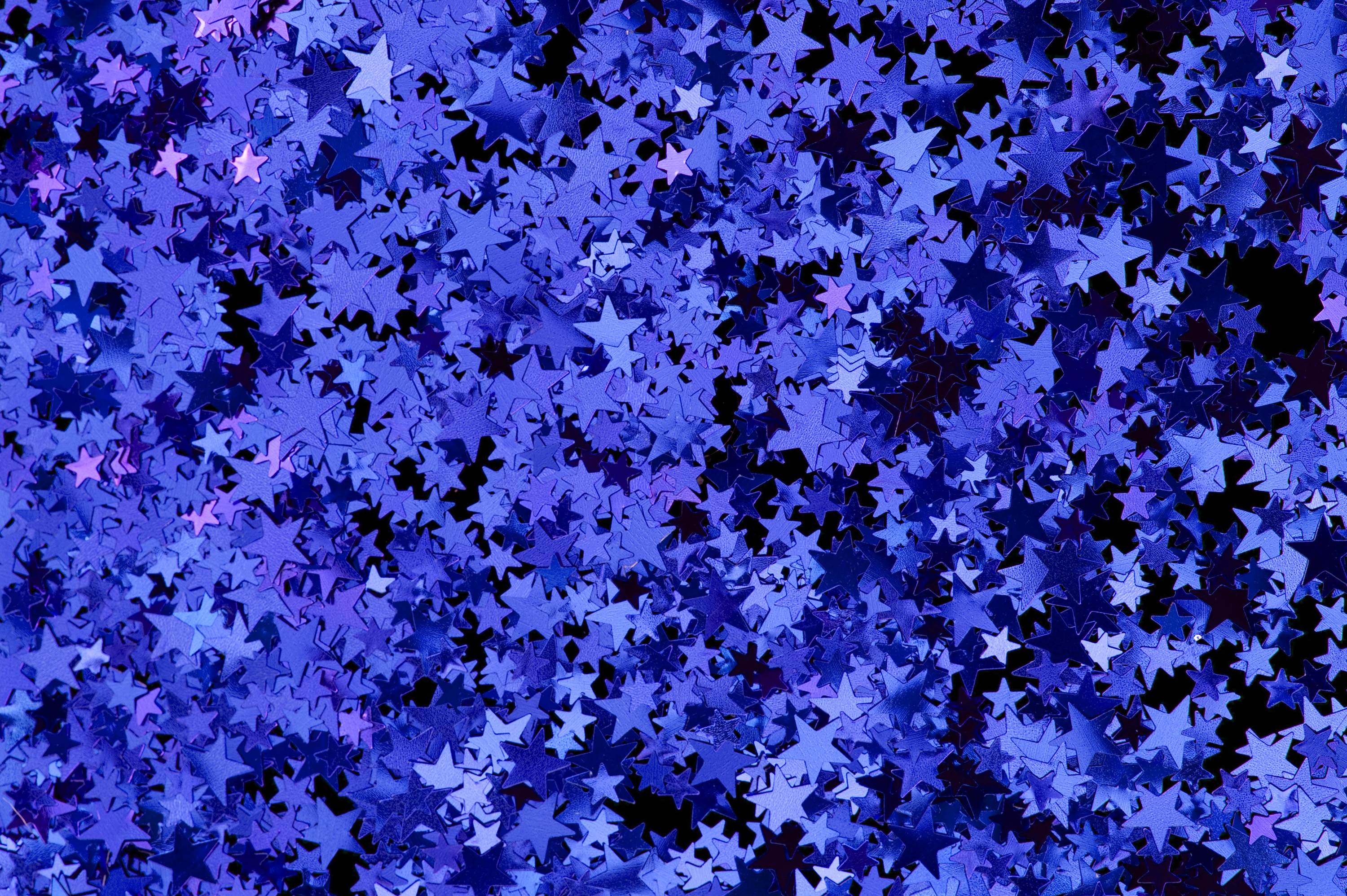 a colorful background of blue and purple star shapes
