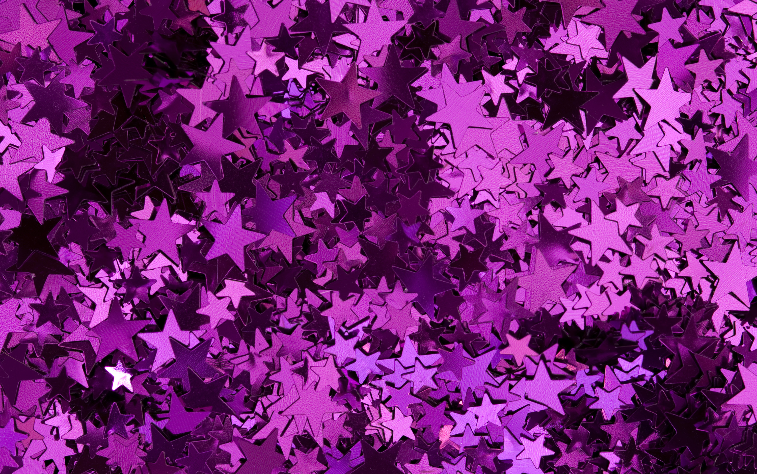 a colorful background of random pink star shapes