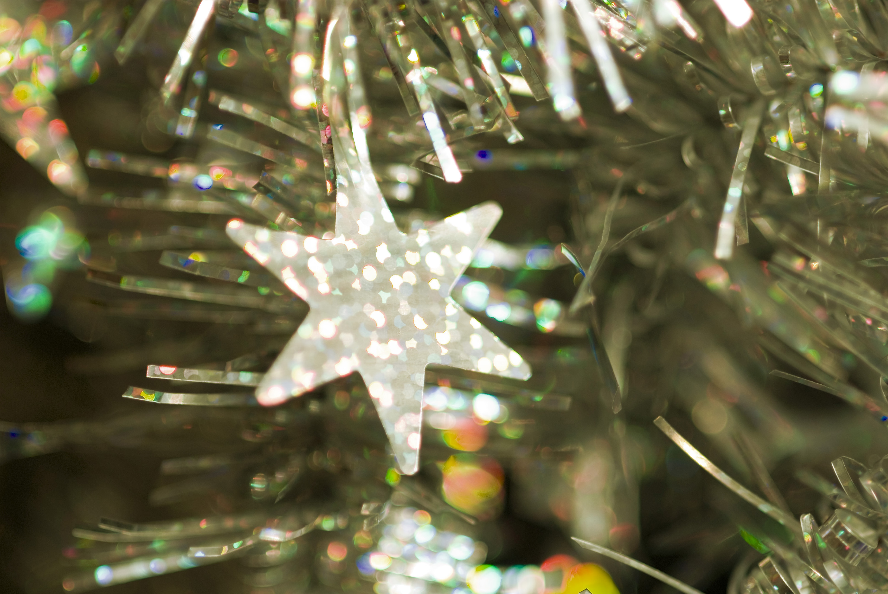 a festive sparkling background of tinsel with decorative star shape