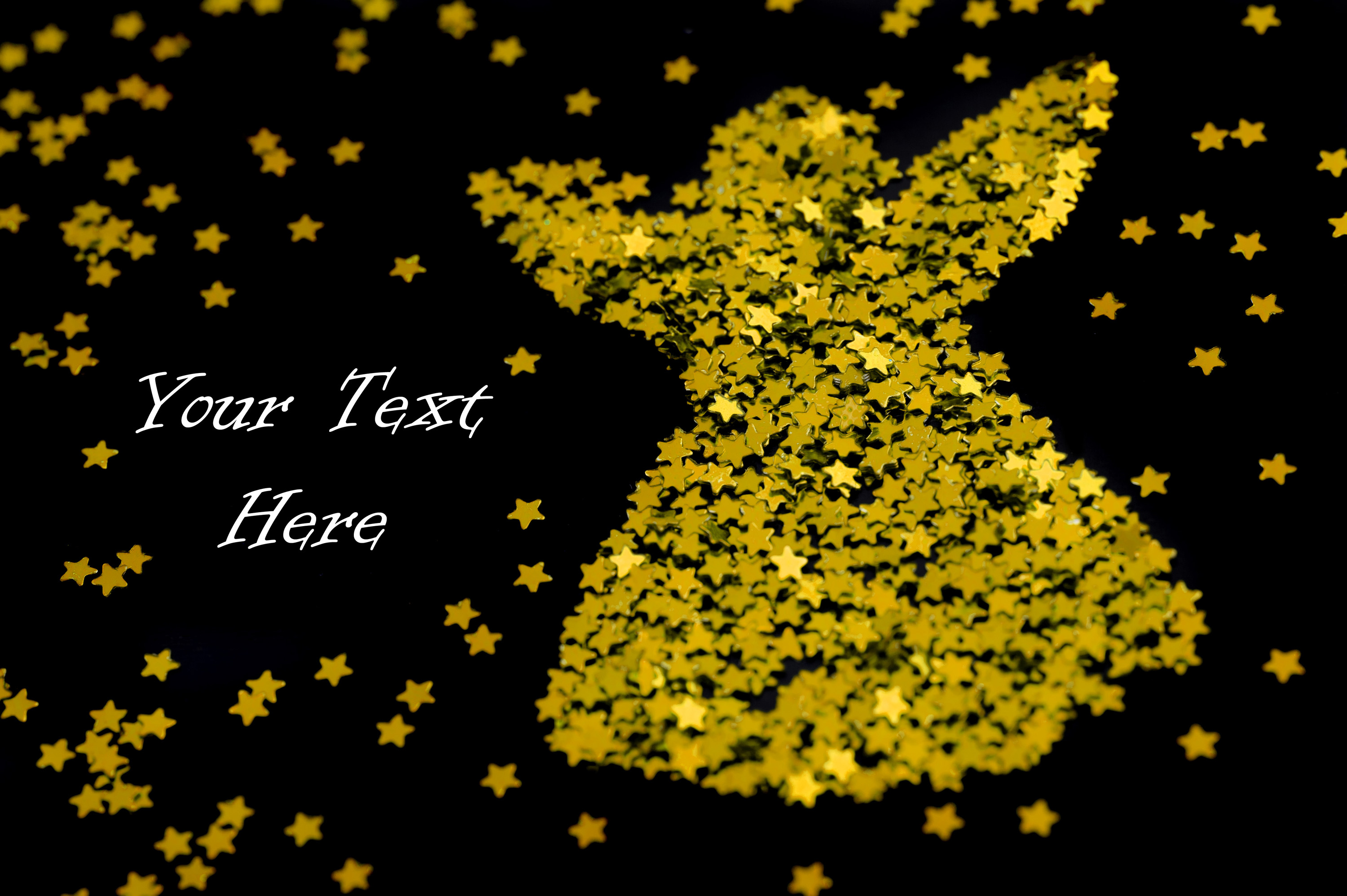 Golden Christmas angel fashioned out of many small gold stars with a scattered star background and copyspace for your text