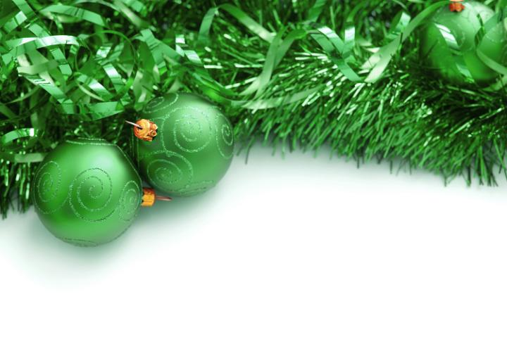 photo of green christmas tinsel and bauble border