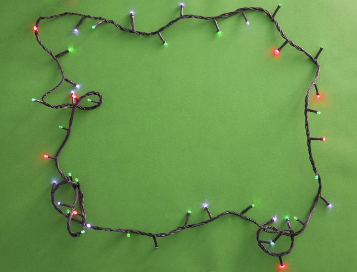 Photo Of Festive Garland On Green Background Free