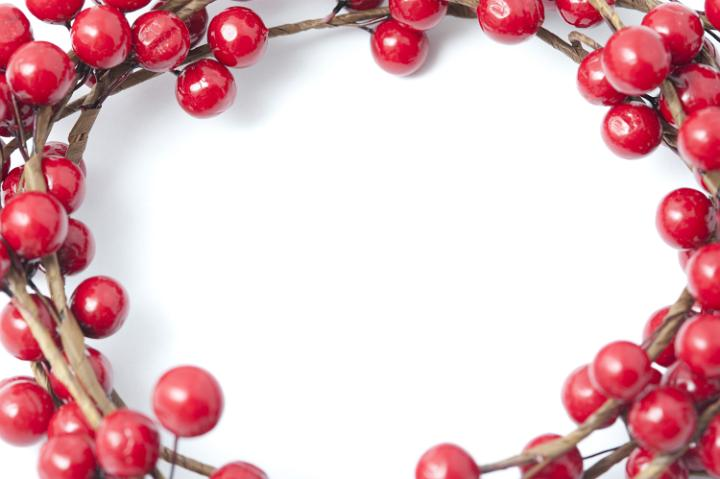 photo of bright red christmas berry border or frame