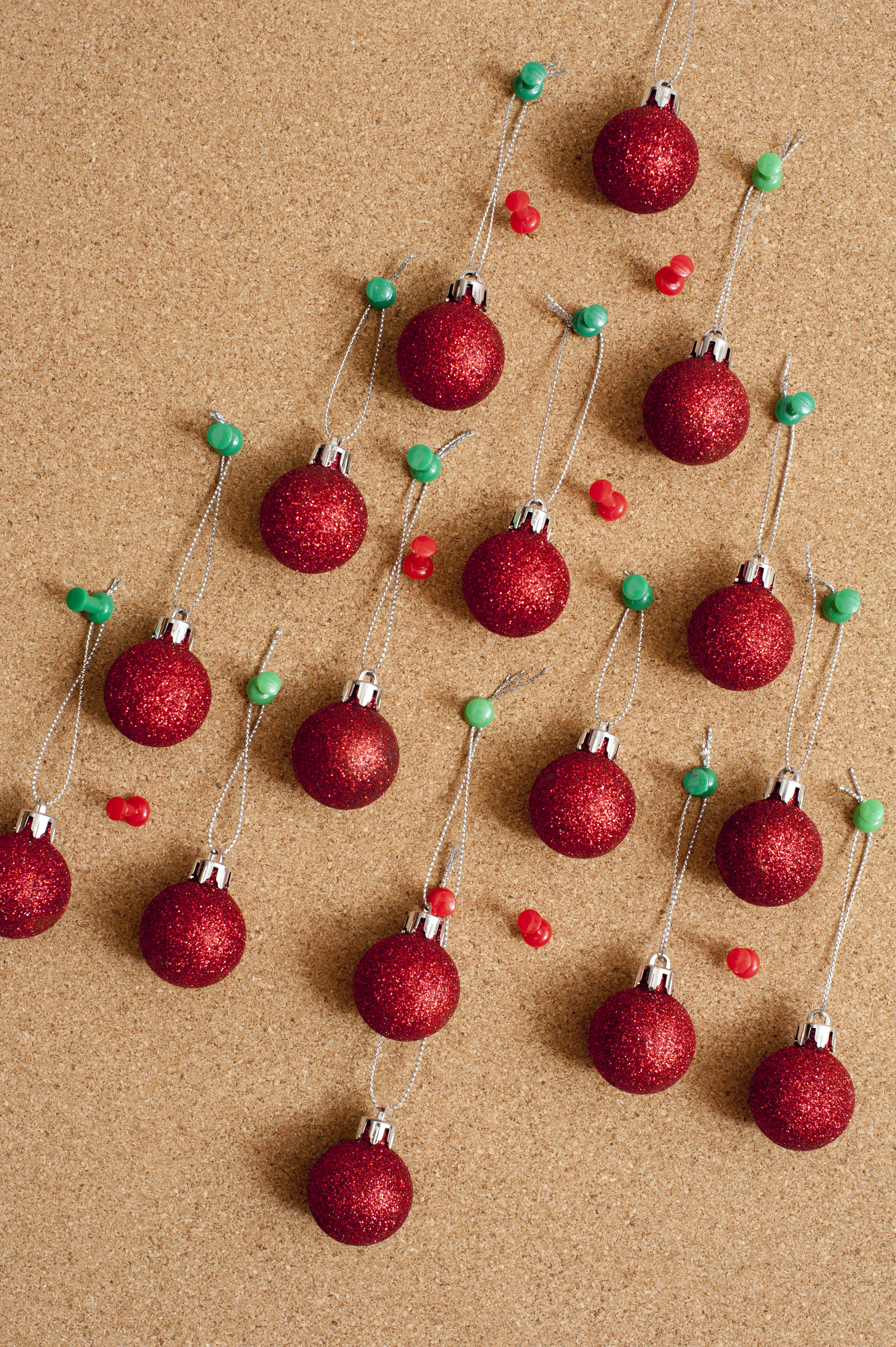 Christmas balls hanging on wooden board