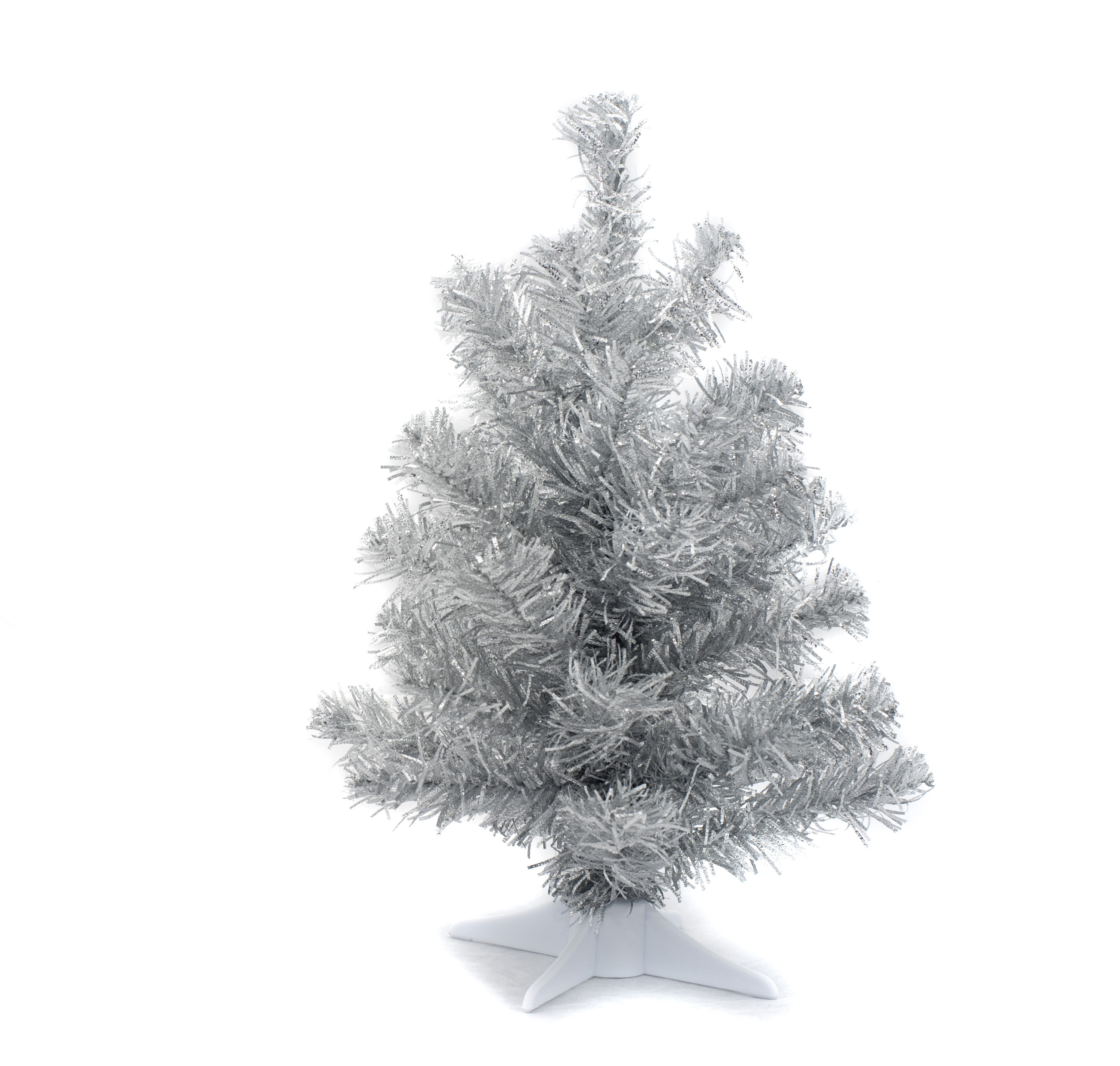 an undecorated silver christmas tree isolated against a white backdrop