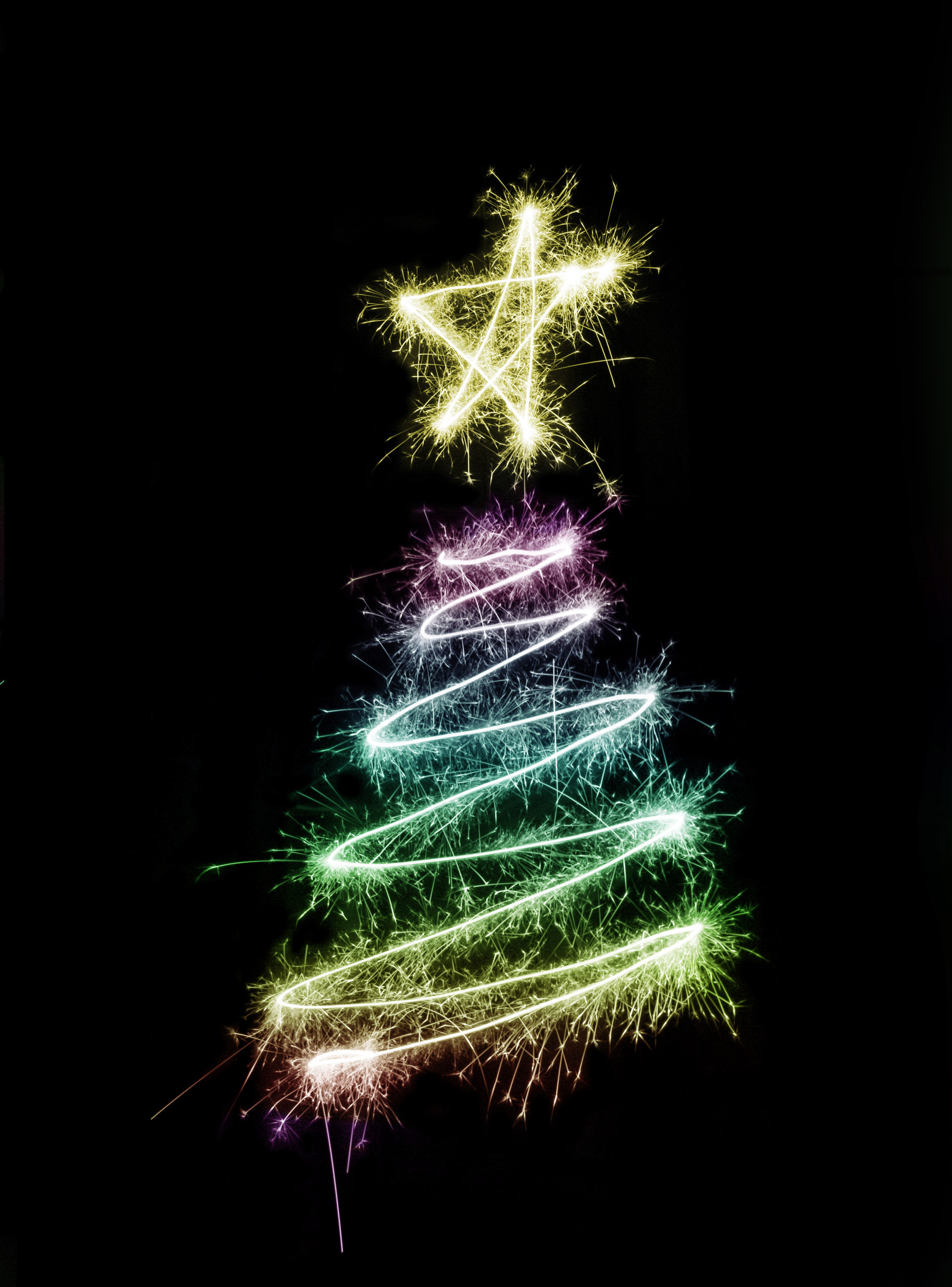 A colorful christmas tree symbol drawn with sparkler trails