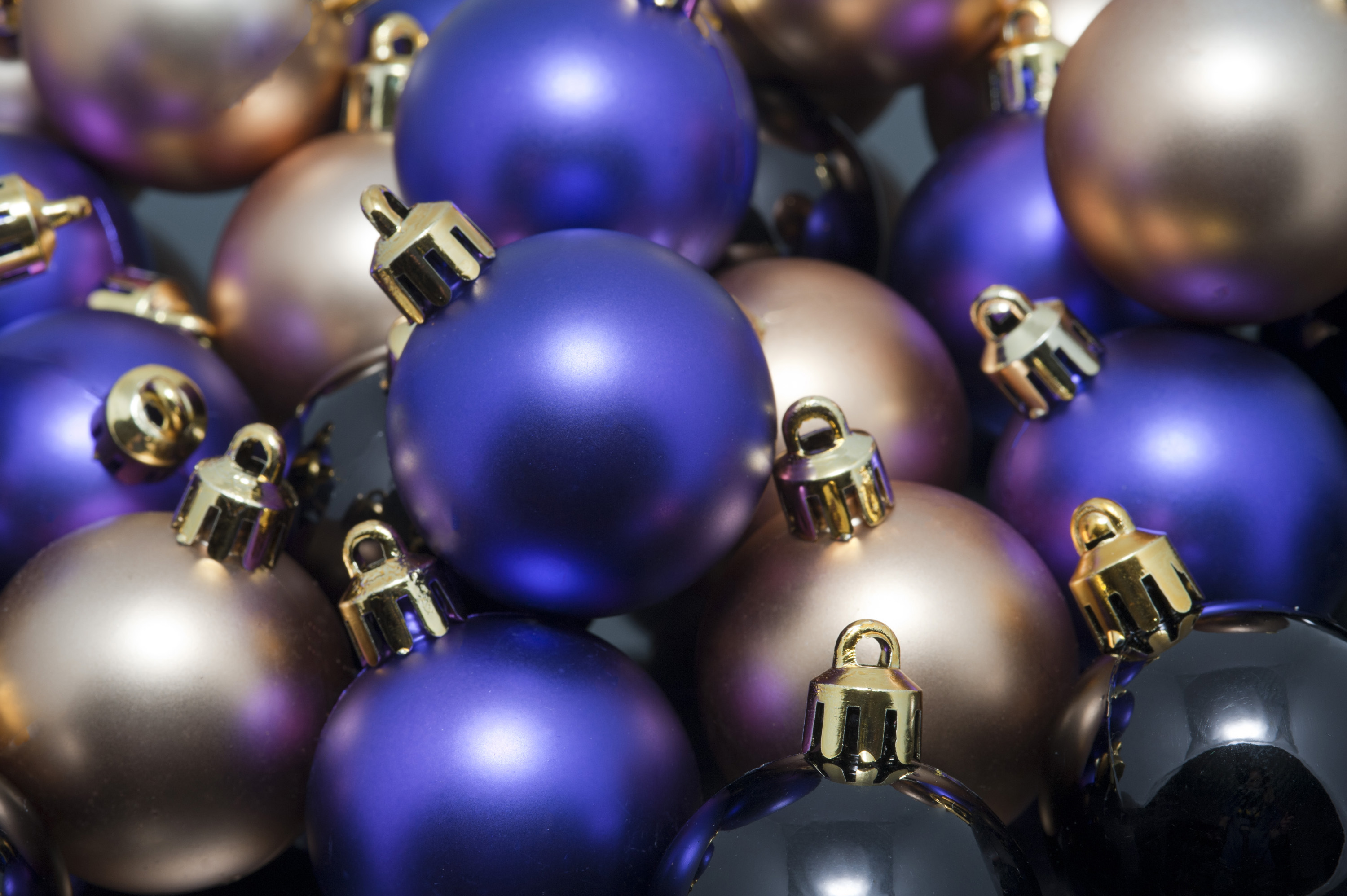 a pile of purple old and black christmas baubles