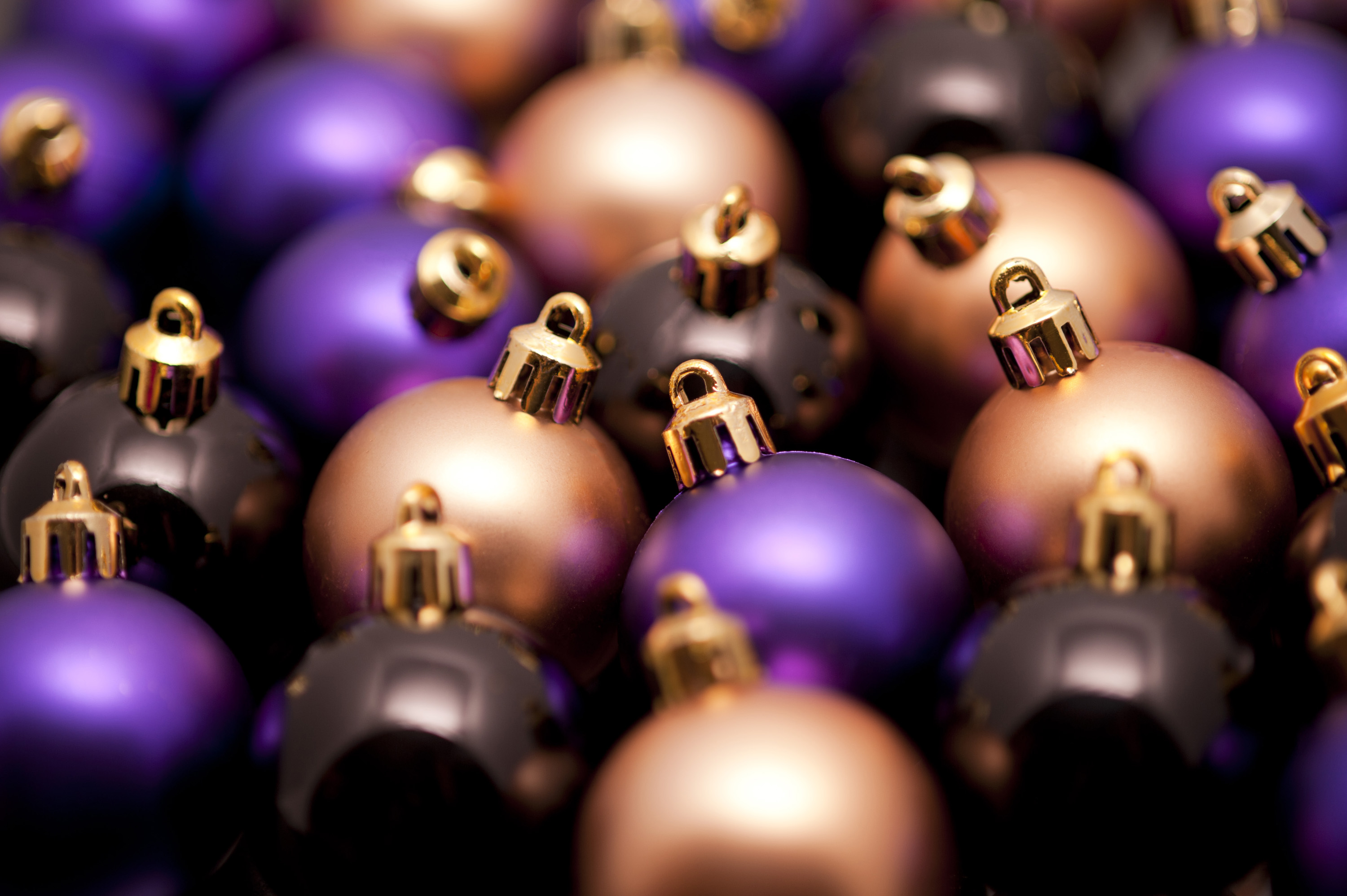 Christmas bauble background with densely packed balls of different colours and shallow dof
