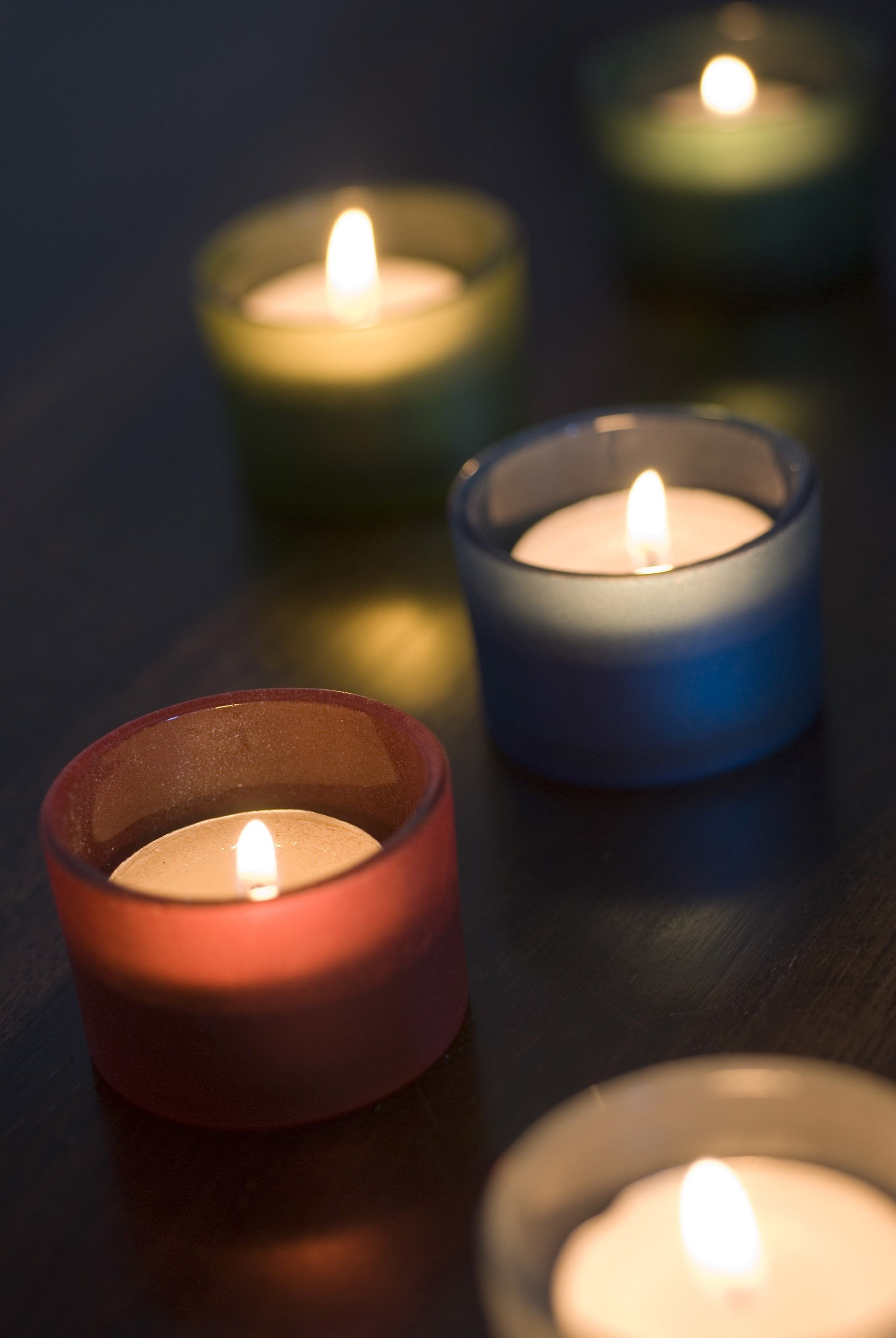 Five different coloured tea light candles