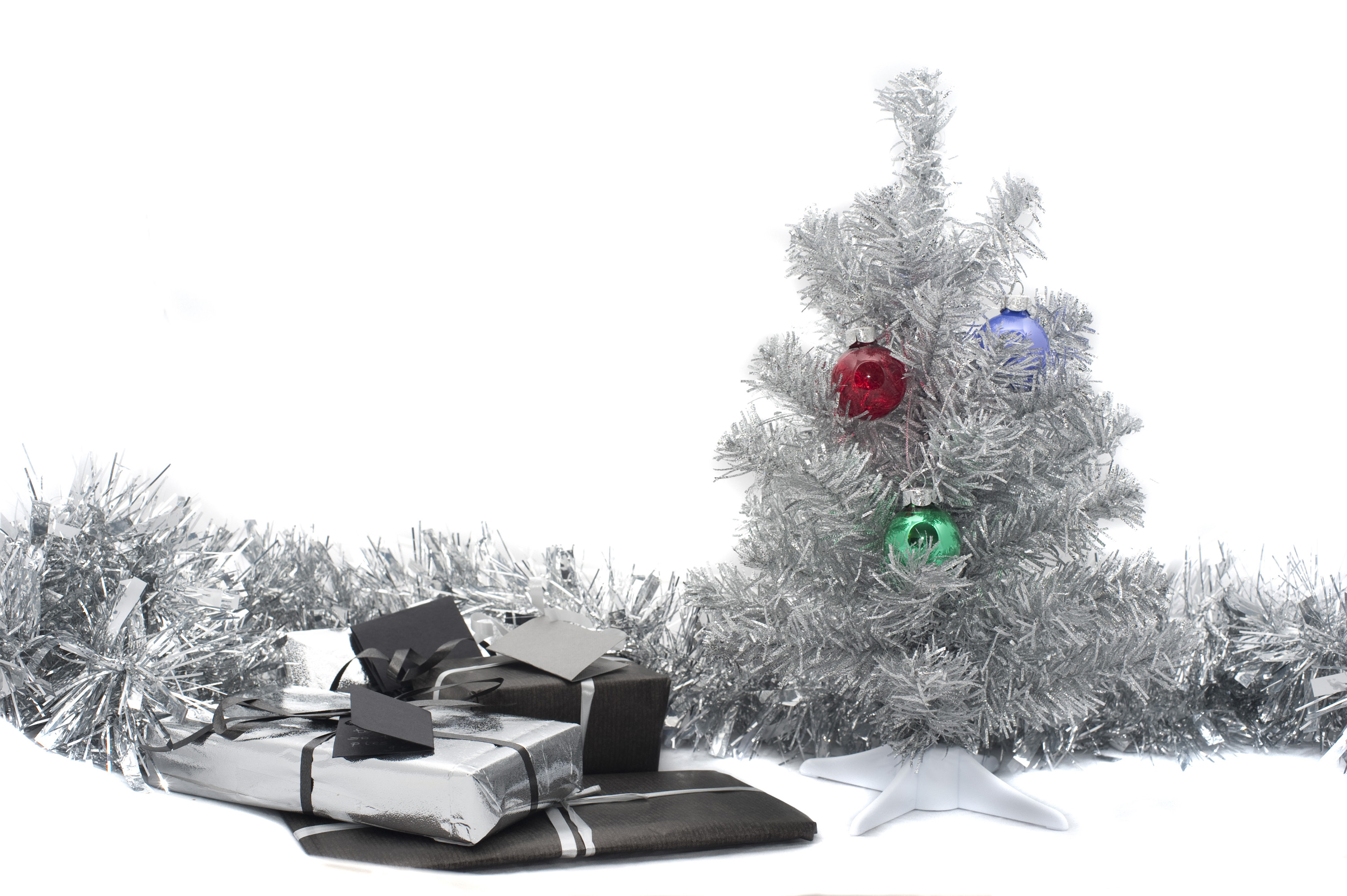 a silver christmas still life - decorative tree and gifts