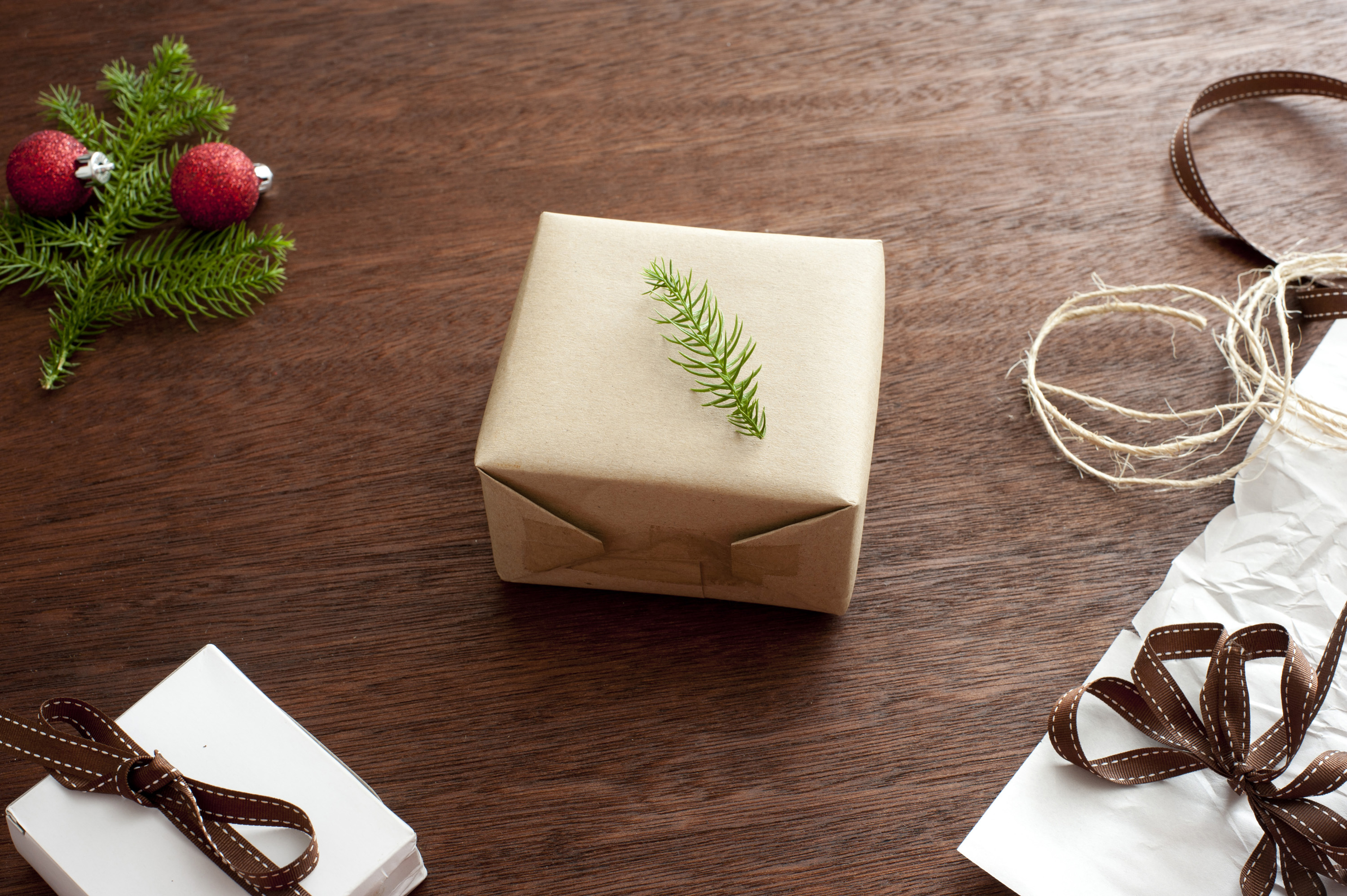 photo of wrapped present with fir tree decoration
