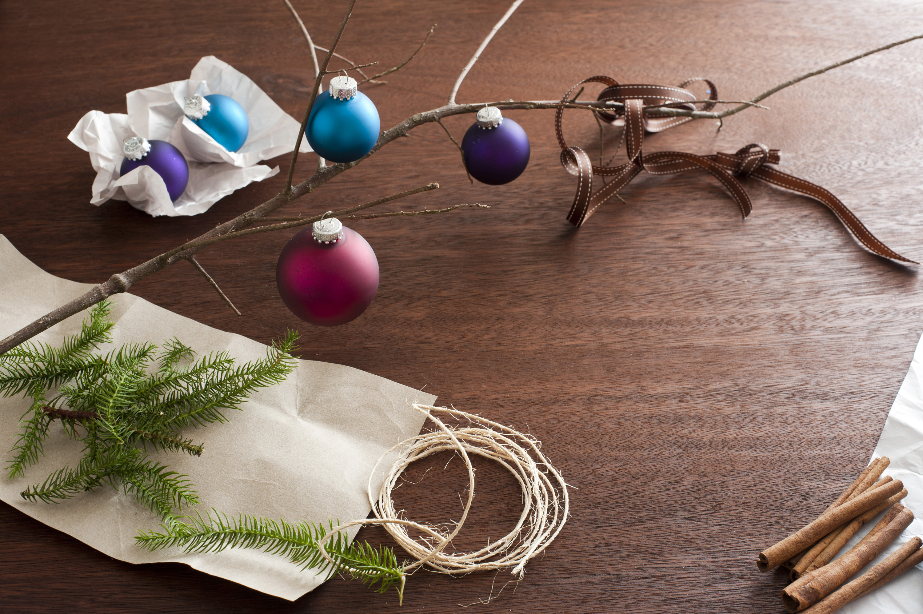Assorted Christmas decorations on a wooden table