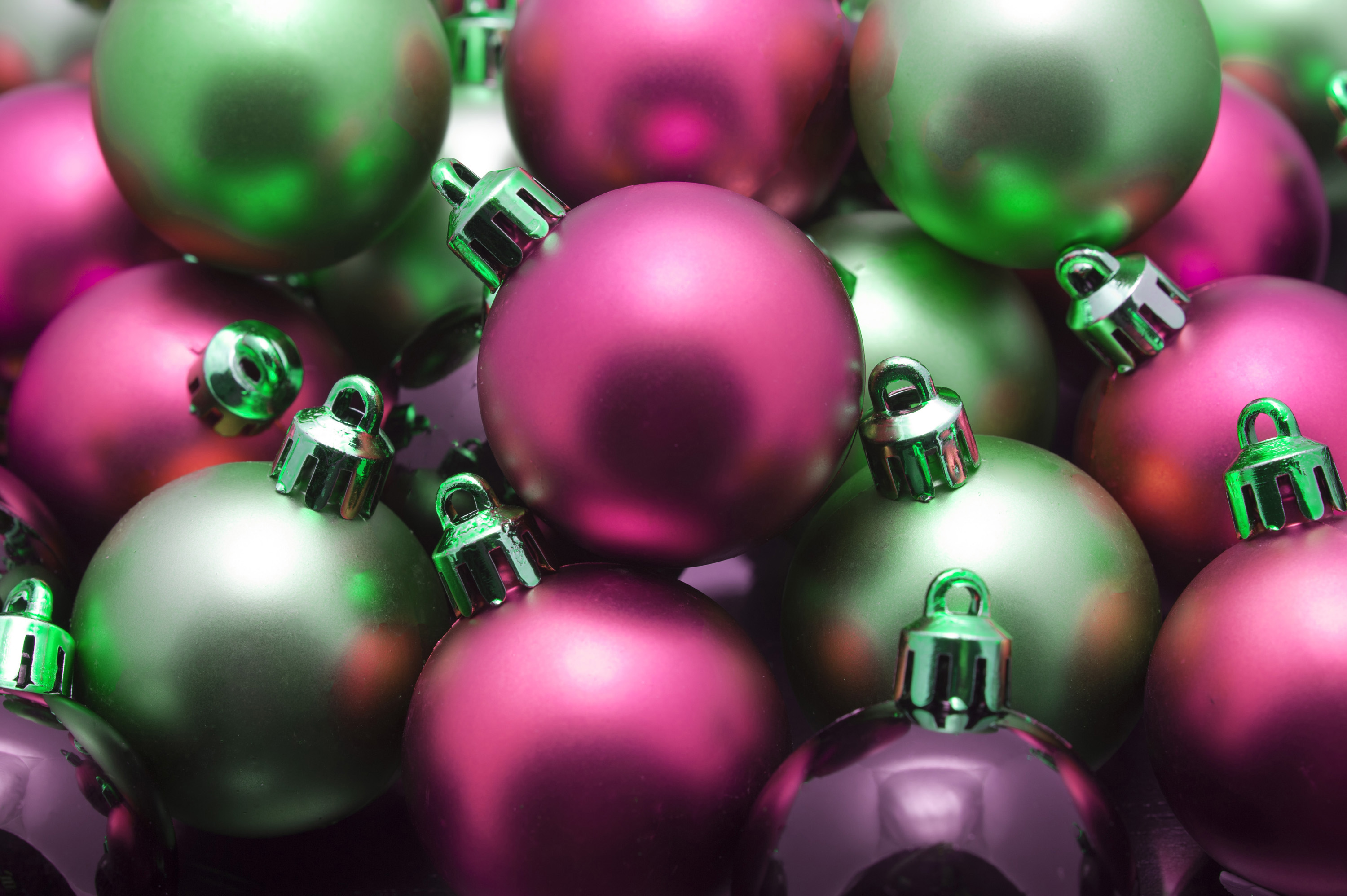 Closeup background of a pile of random red and green Xmas baubles for your Christmas greeting