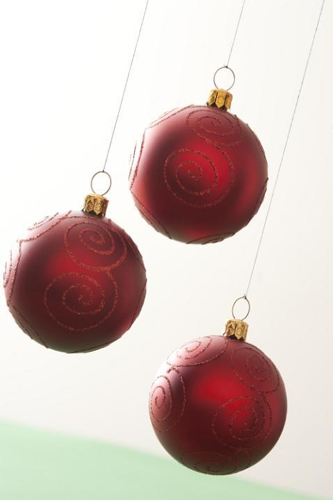 Photo Of Three Red Christmas Balls Hanging On White