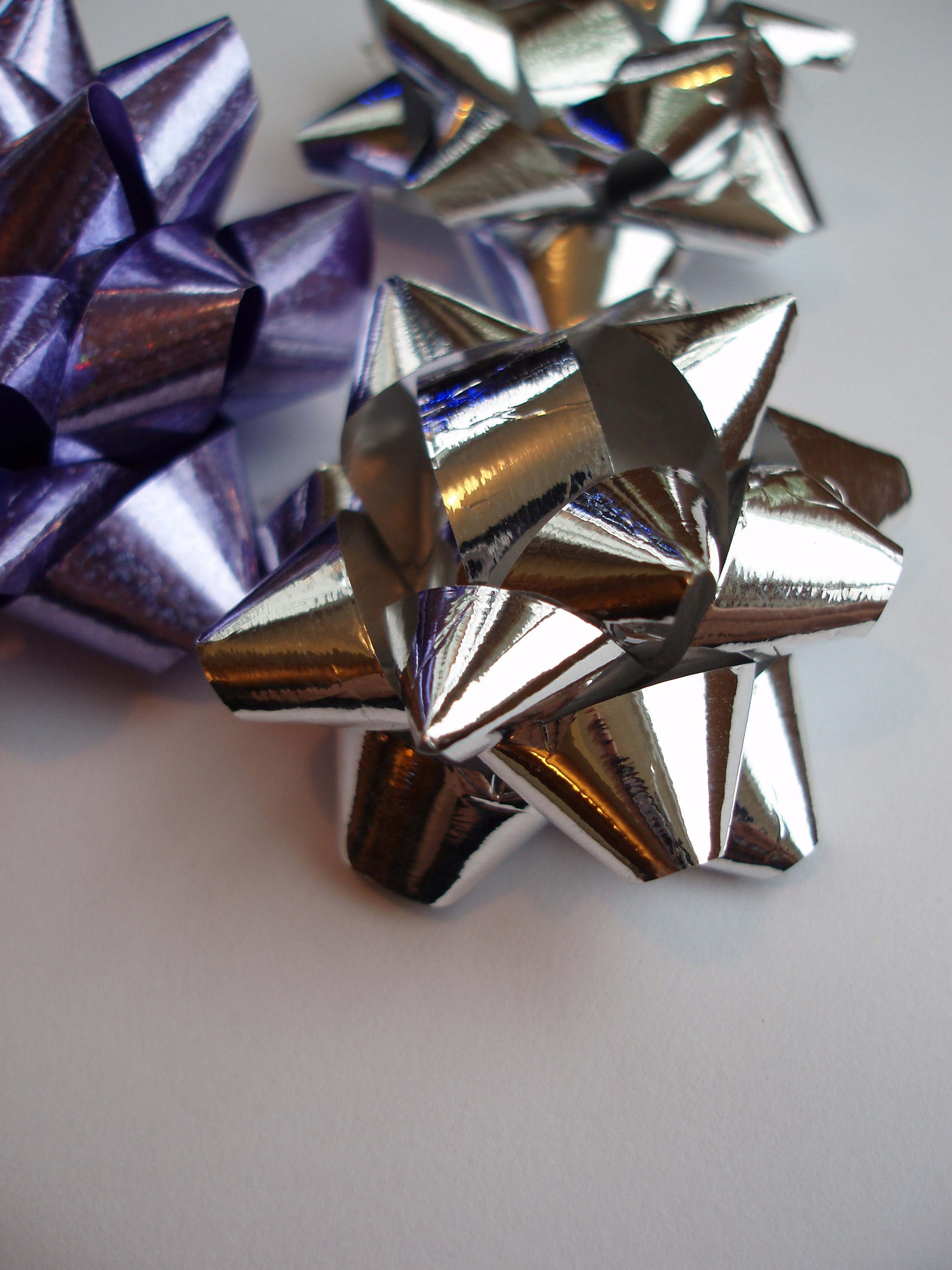 a decorative background image of reflective metalic wrapping bows