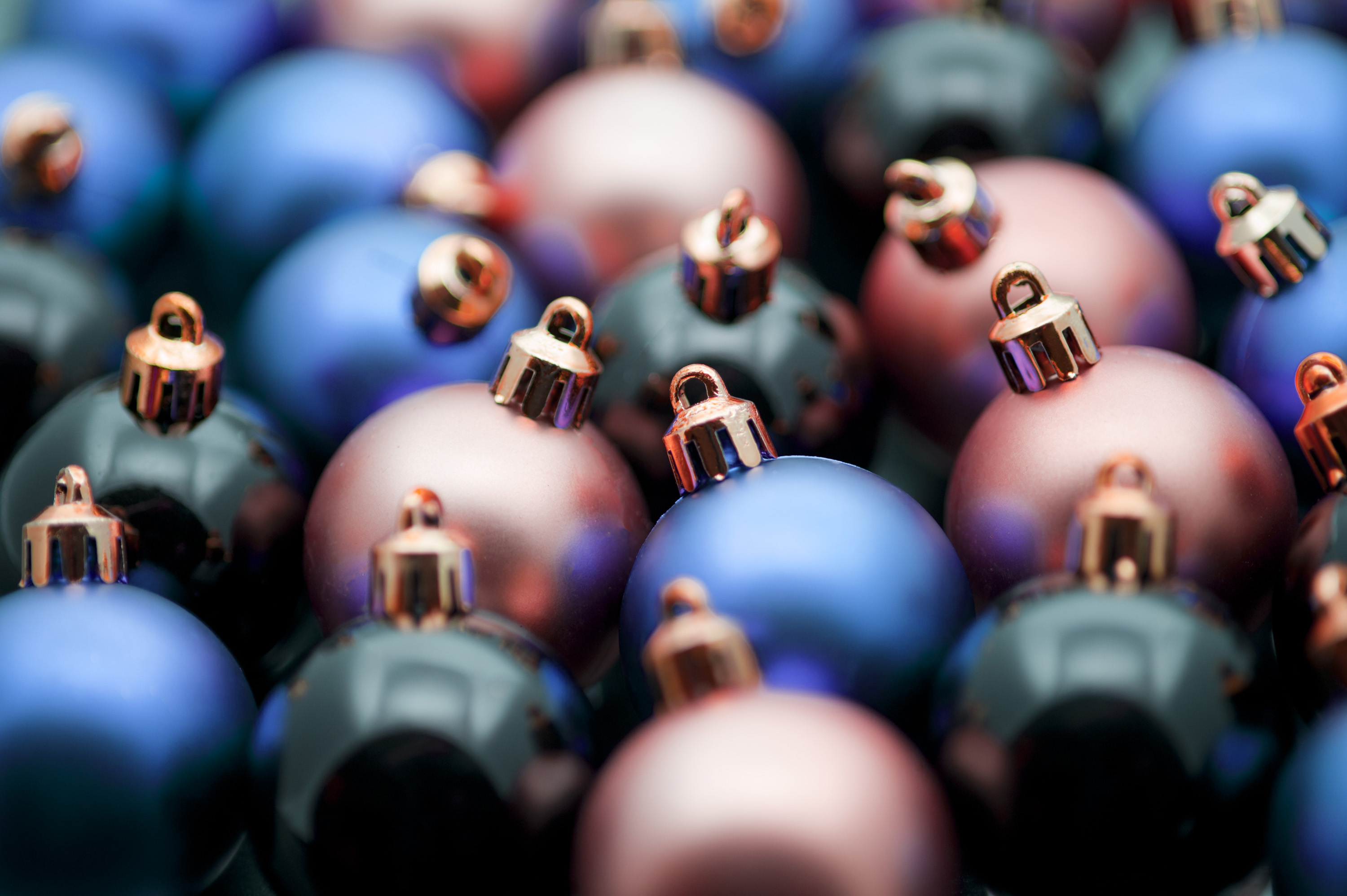 Xmas decorations background with very shallow dof on blue, red and black baubles or balls