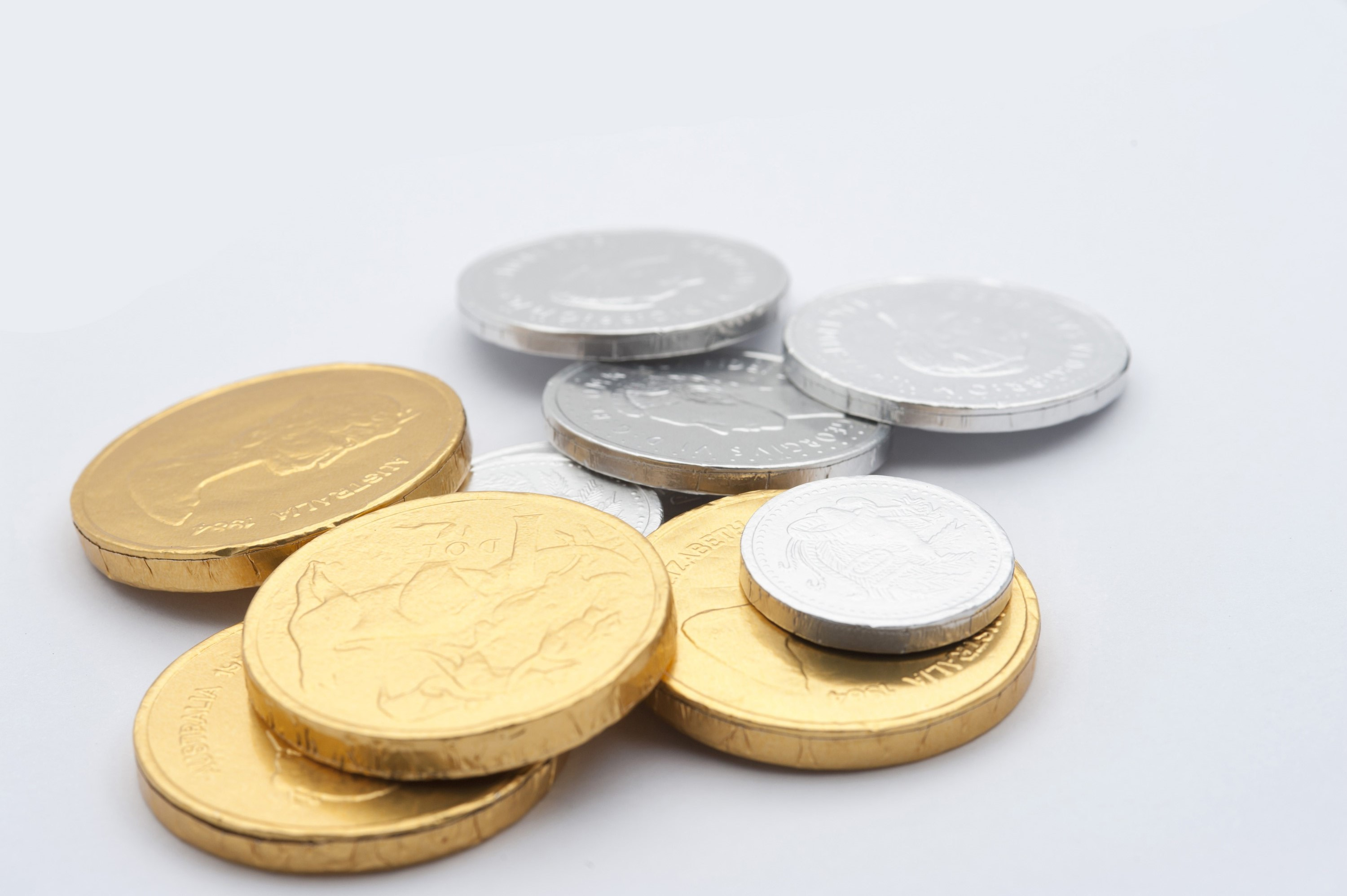 Gold and silver chocolate coins wrapped in metallic foil for a special candy treat on a festive occasion