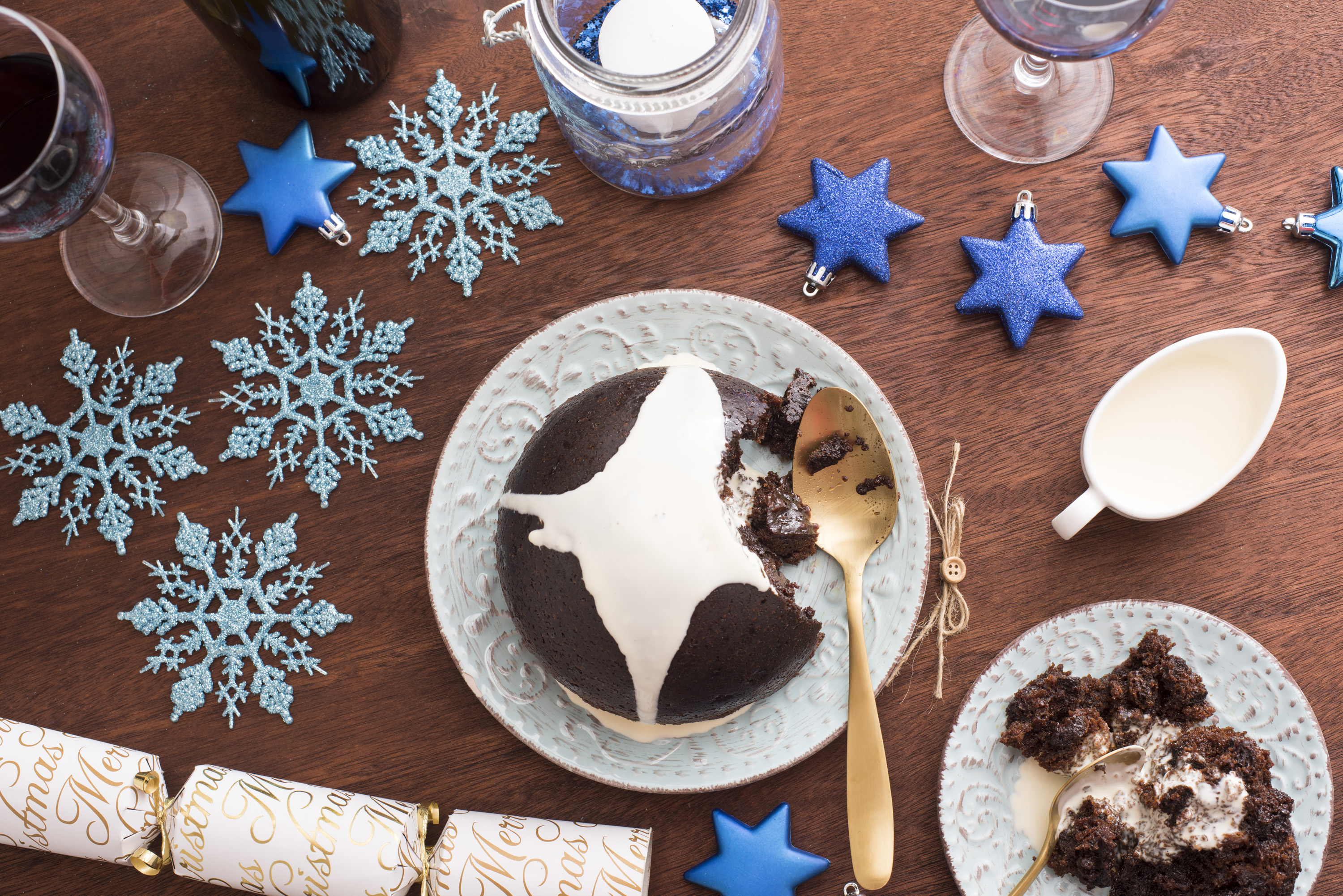 An array of xmas decorations and achristmas pudding e on a plate