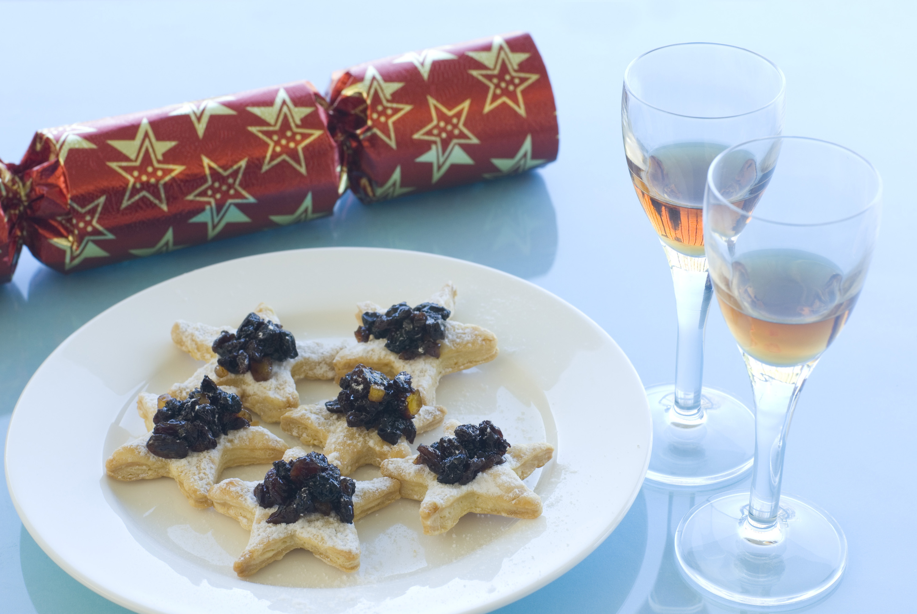 christmas snack appetisers,  mincemeat pastries with glasses of sherry