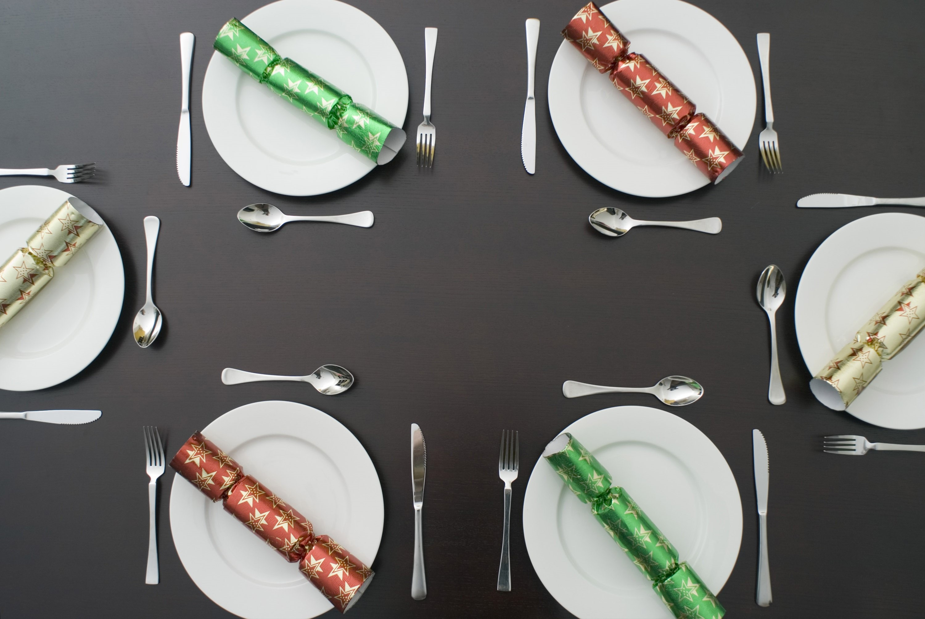 a festive dinner table set up for 6 people to enjoy a celebration meal