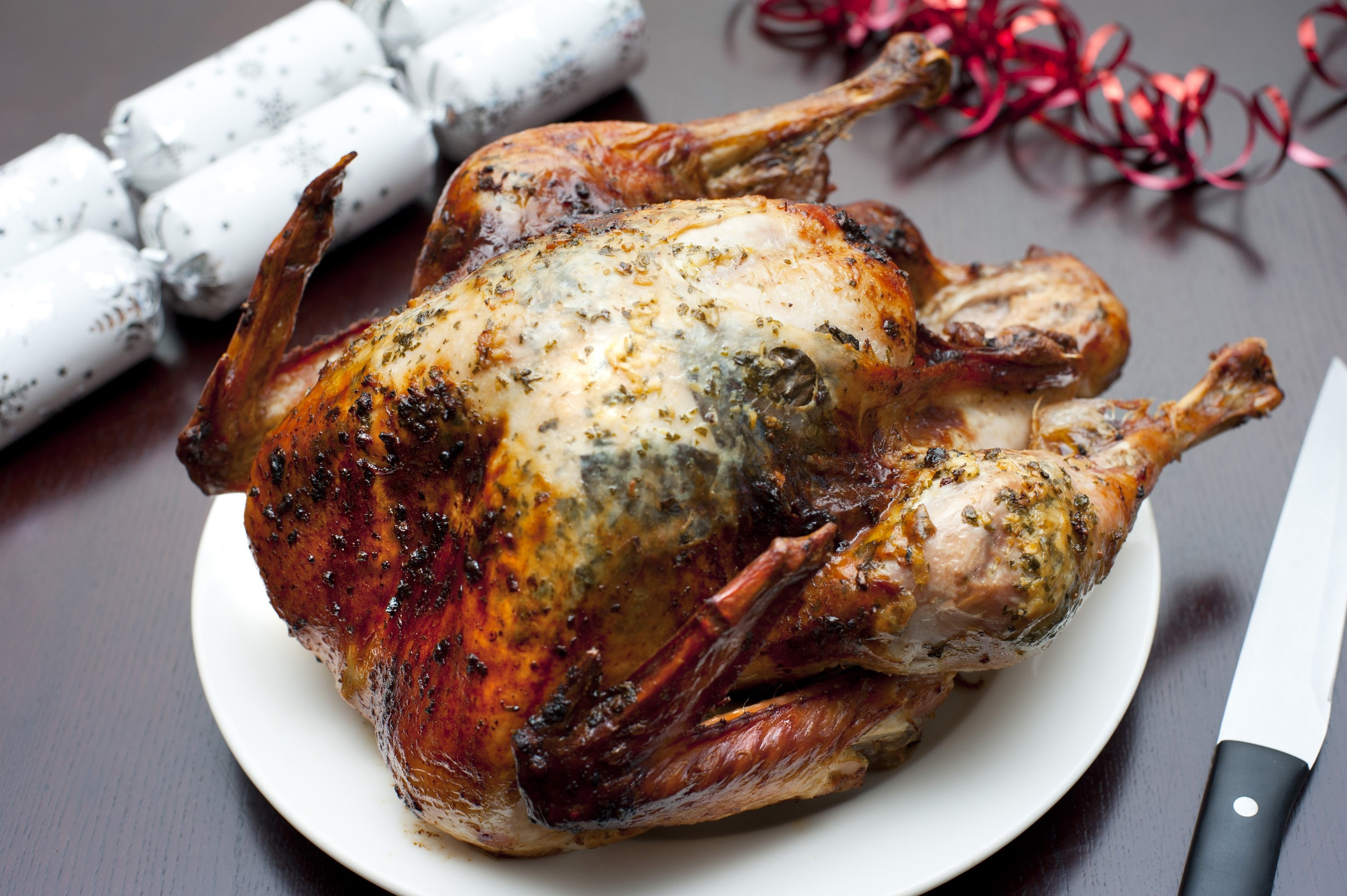 High angle view of a crispy whole roast festive turkey on a plate for Christmas or Thanksgiving celebrations