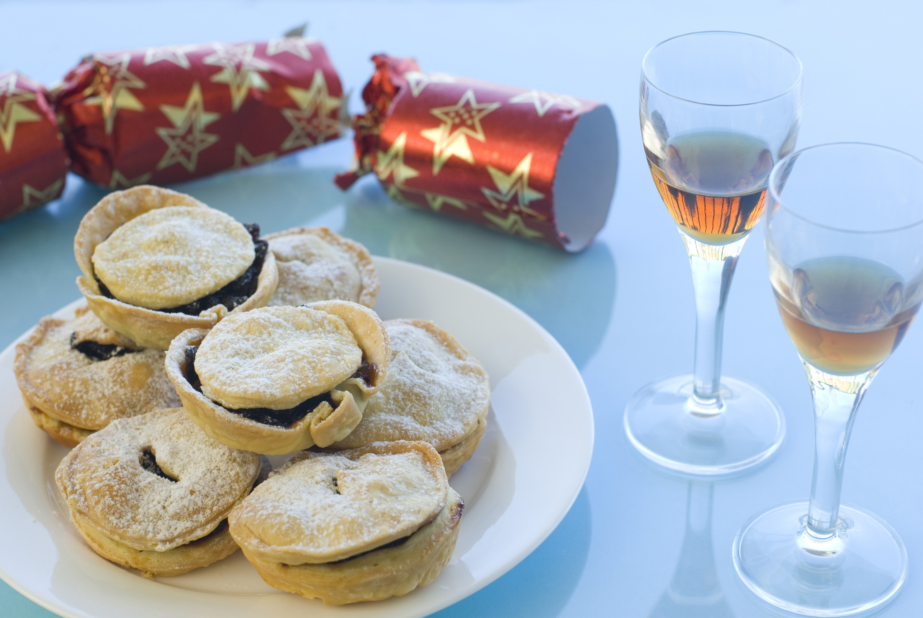 a plate of christmas mincemeat pies and a pulled christmas cracker