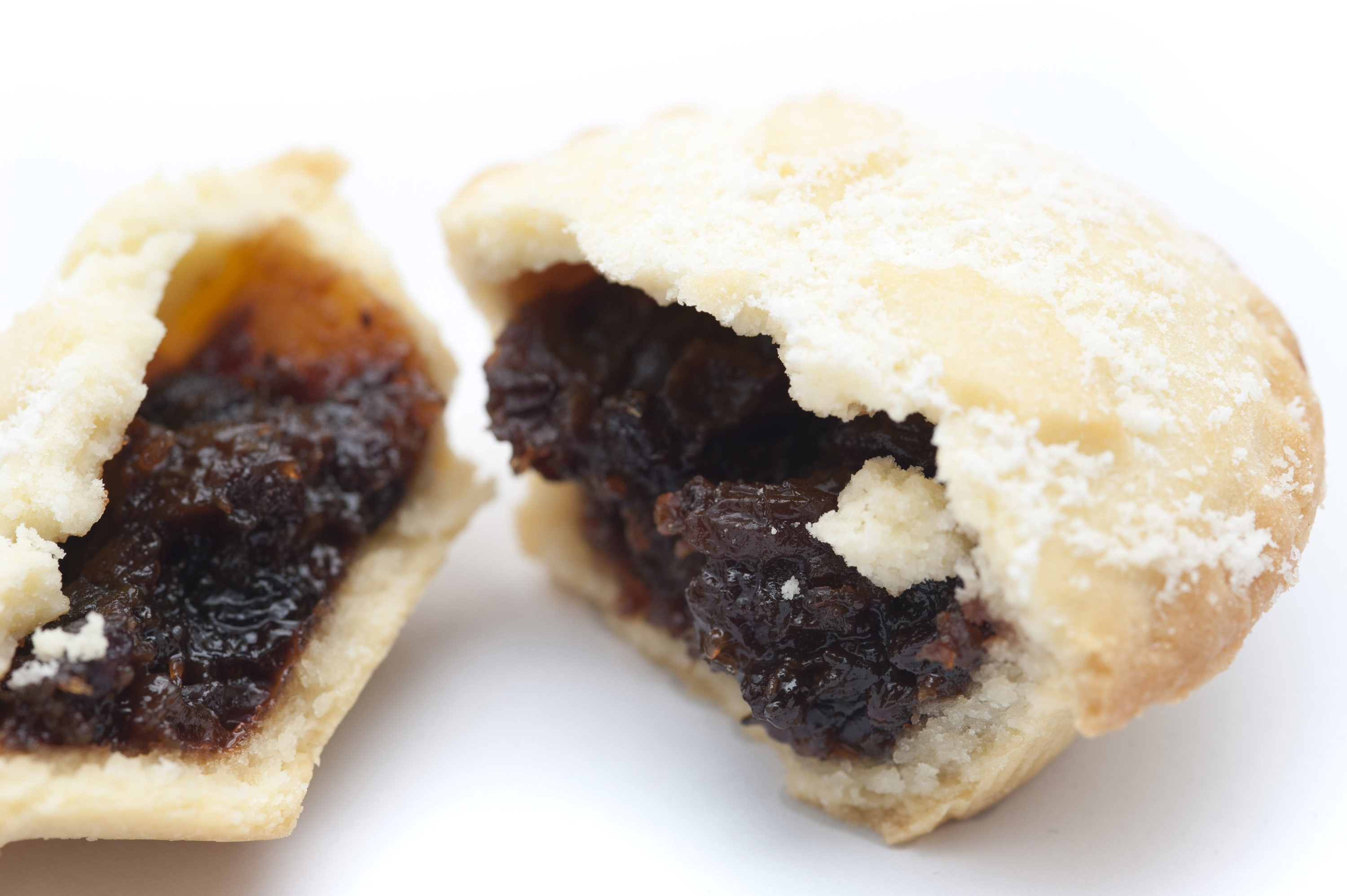 Close up detail of the rich fruity filling in a Christmas mince pie which has been broken open , focus to the filling