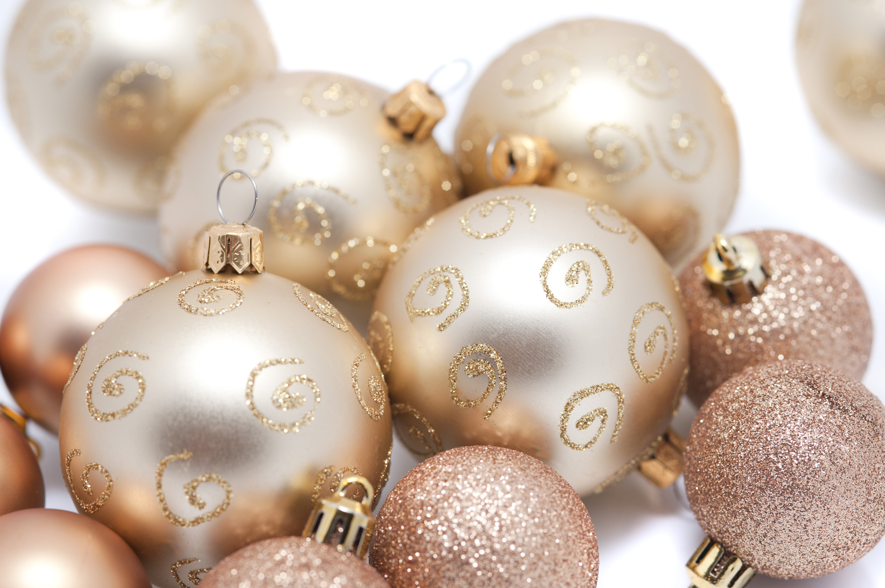 a background of gold coloured christmas baubles of various sizes