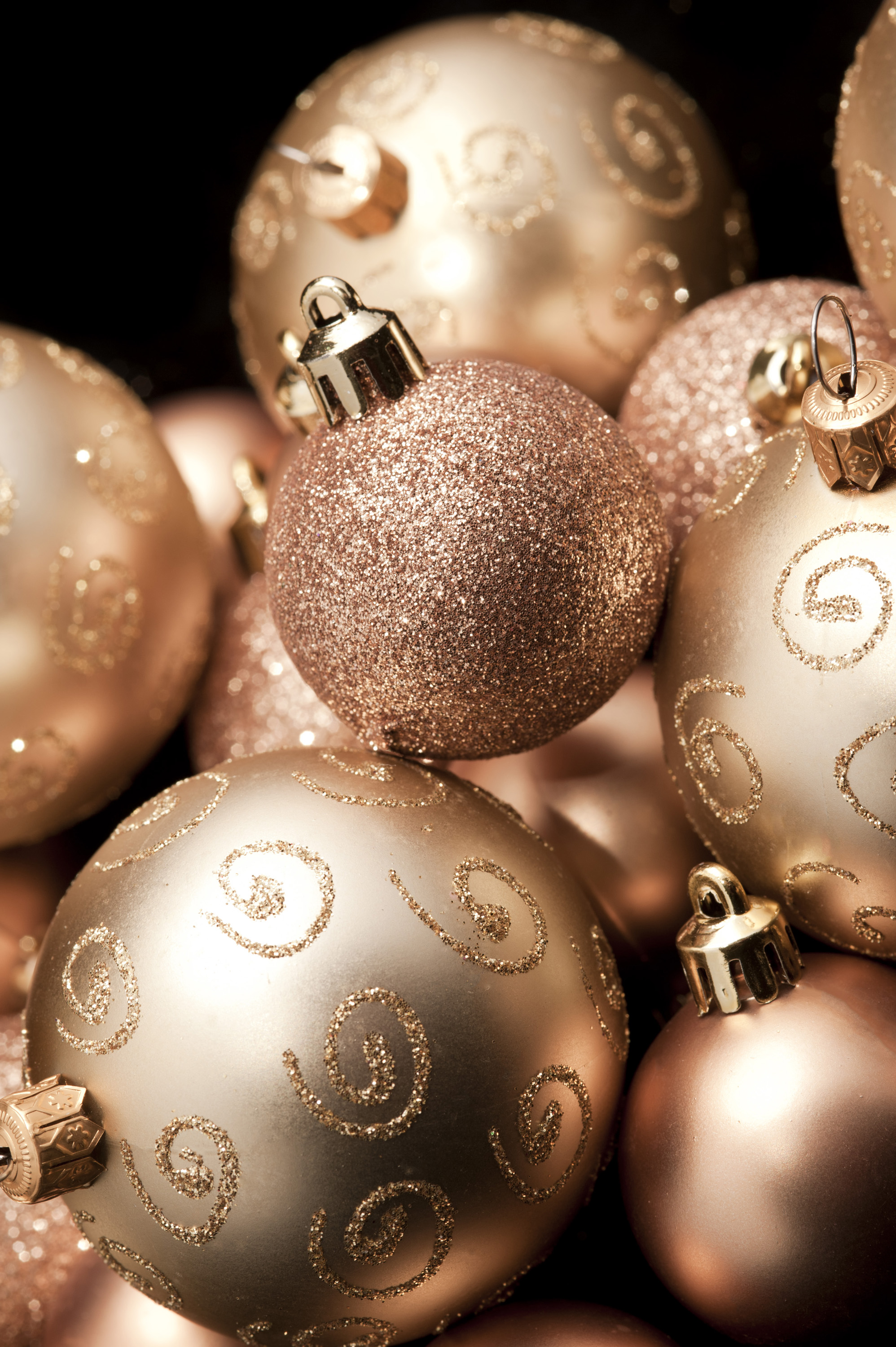 an arrangement of gold coloued glitter decorated sparkly christmas baubles