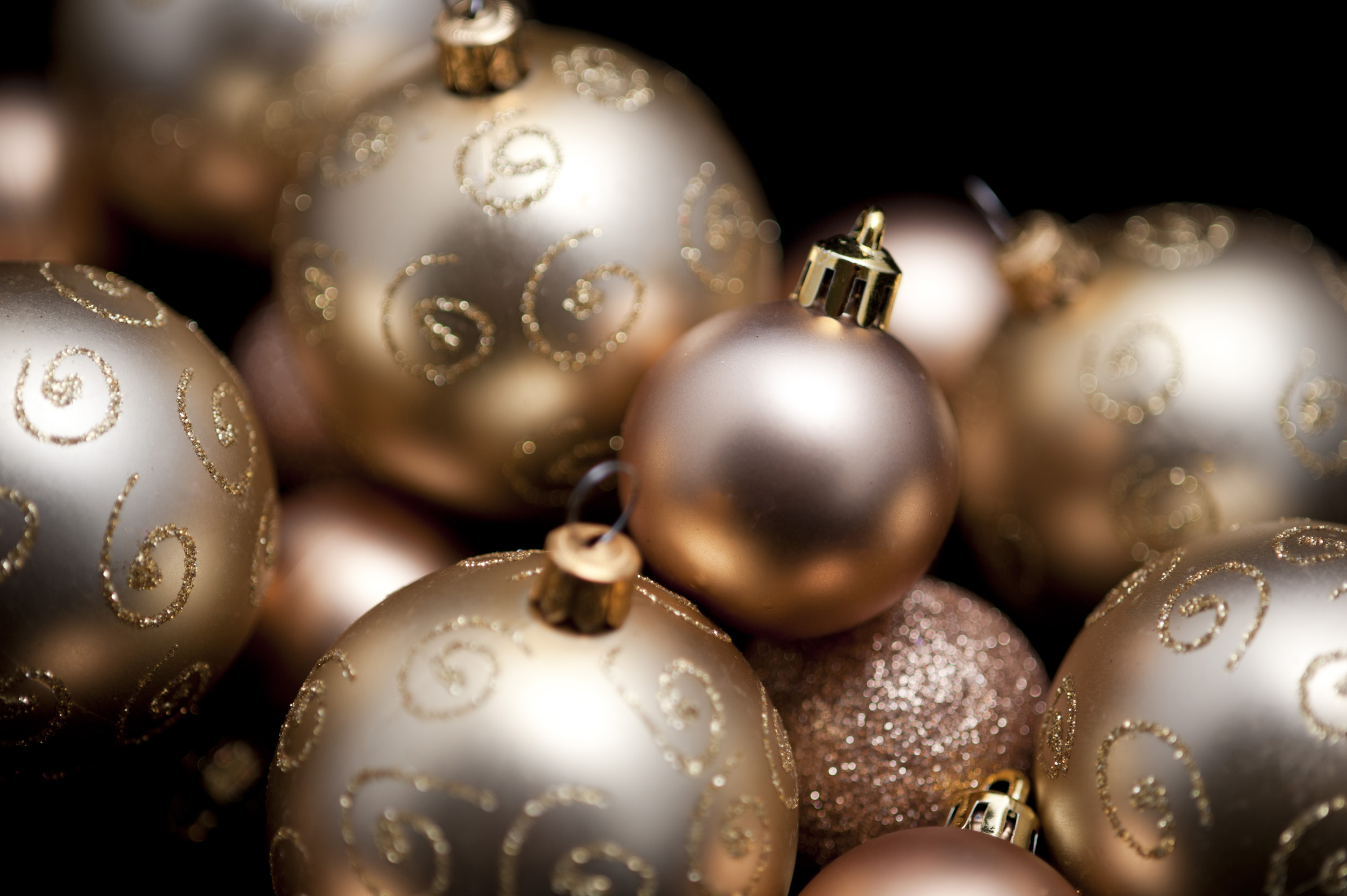 gold coloured christmas baubles pictured with narrow depth of field allow text to be over laid