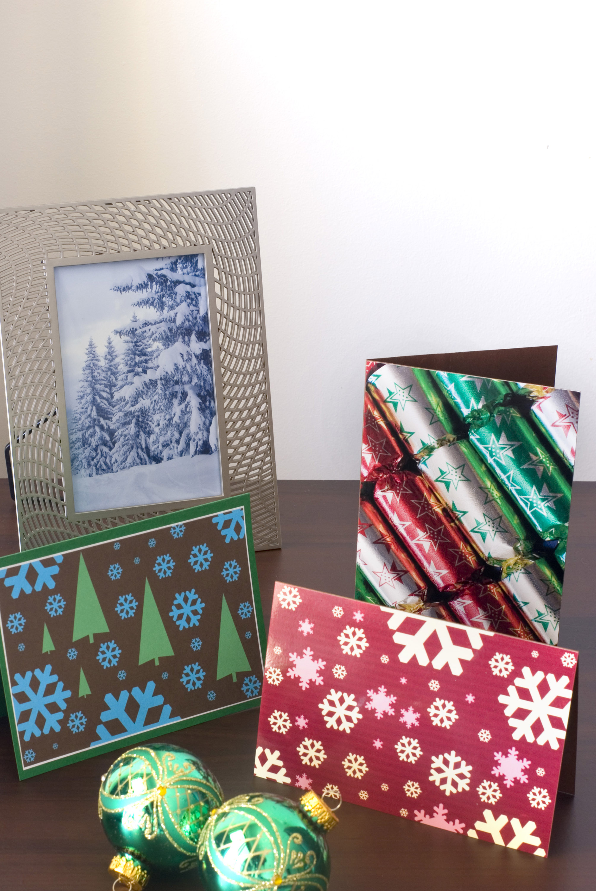 a festive still life image of a winter photo in a frame, christmas cards and ornaments