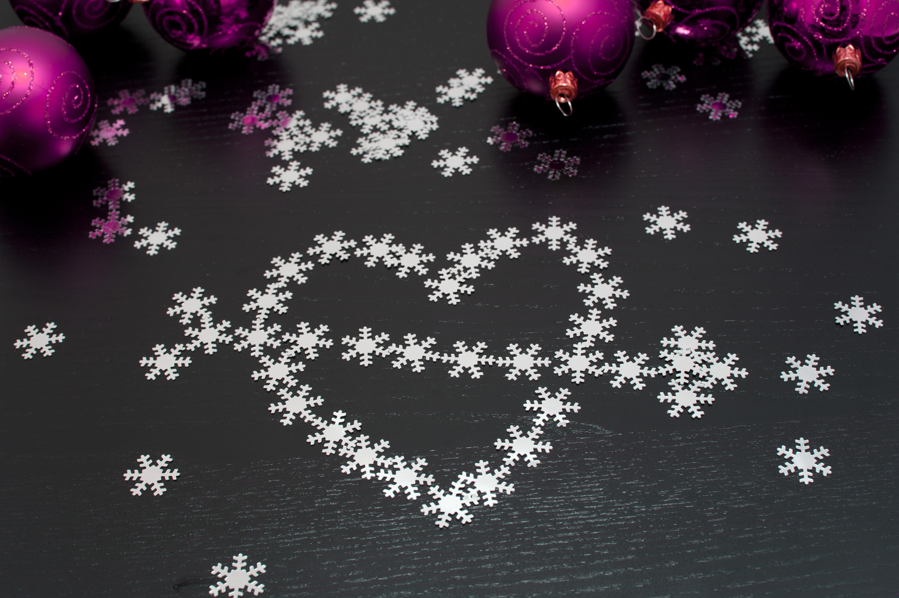Christmas heart and arrow formed of multiple small snowflakes for your message of love and hope at Christmas