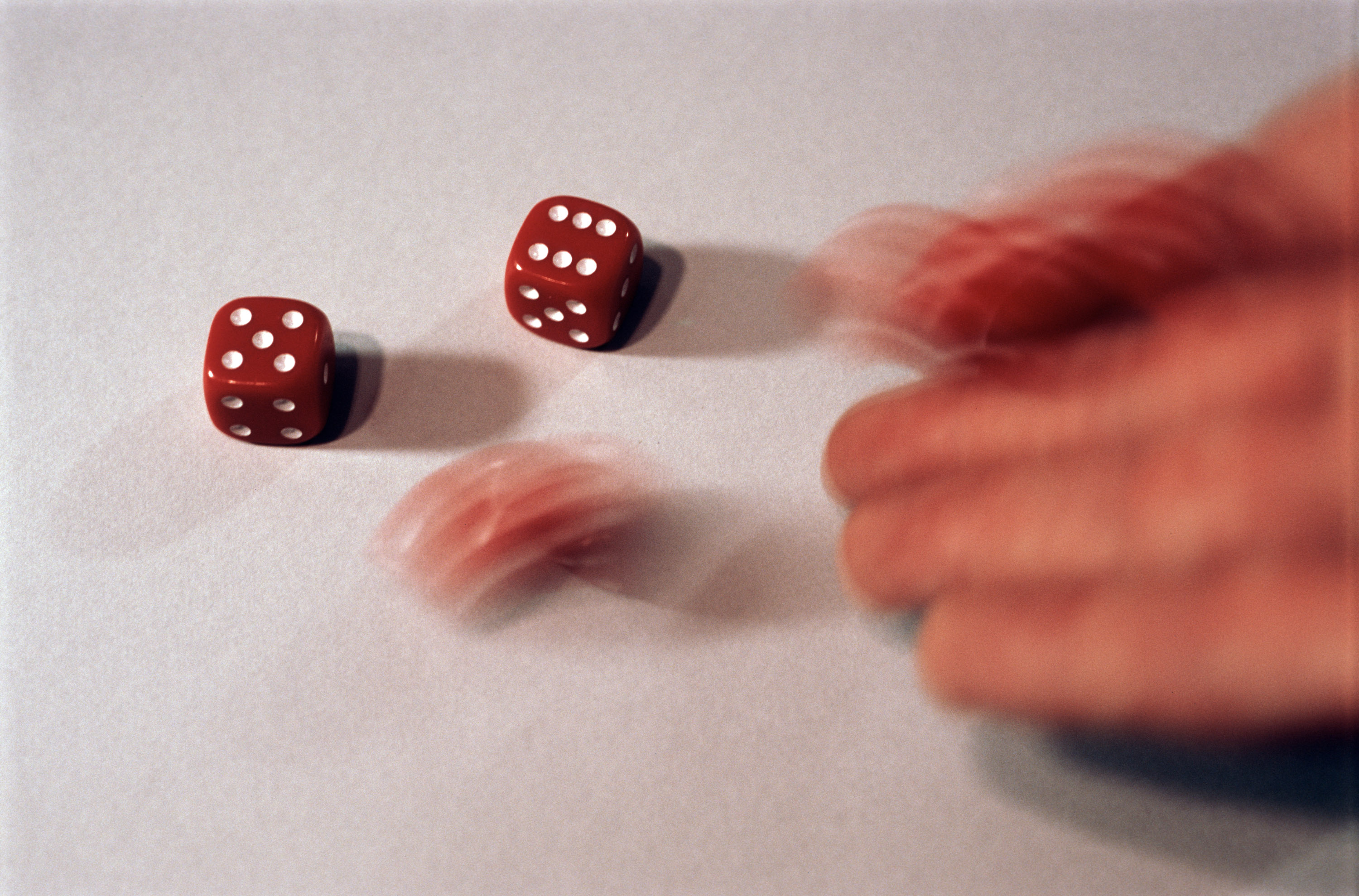christmas board games, a blurred hand throwing several red dice