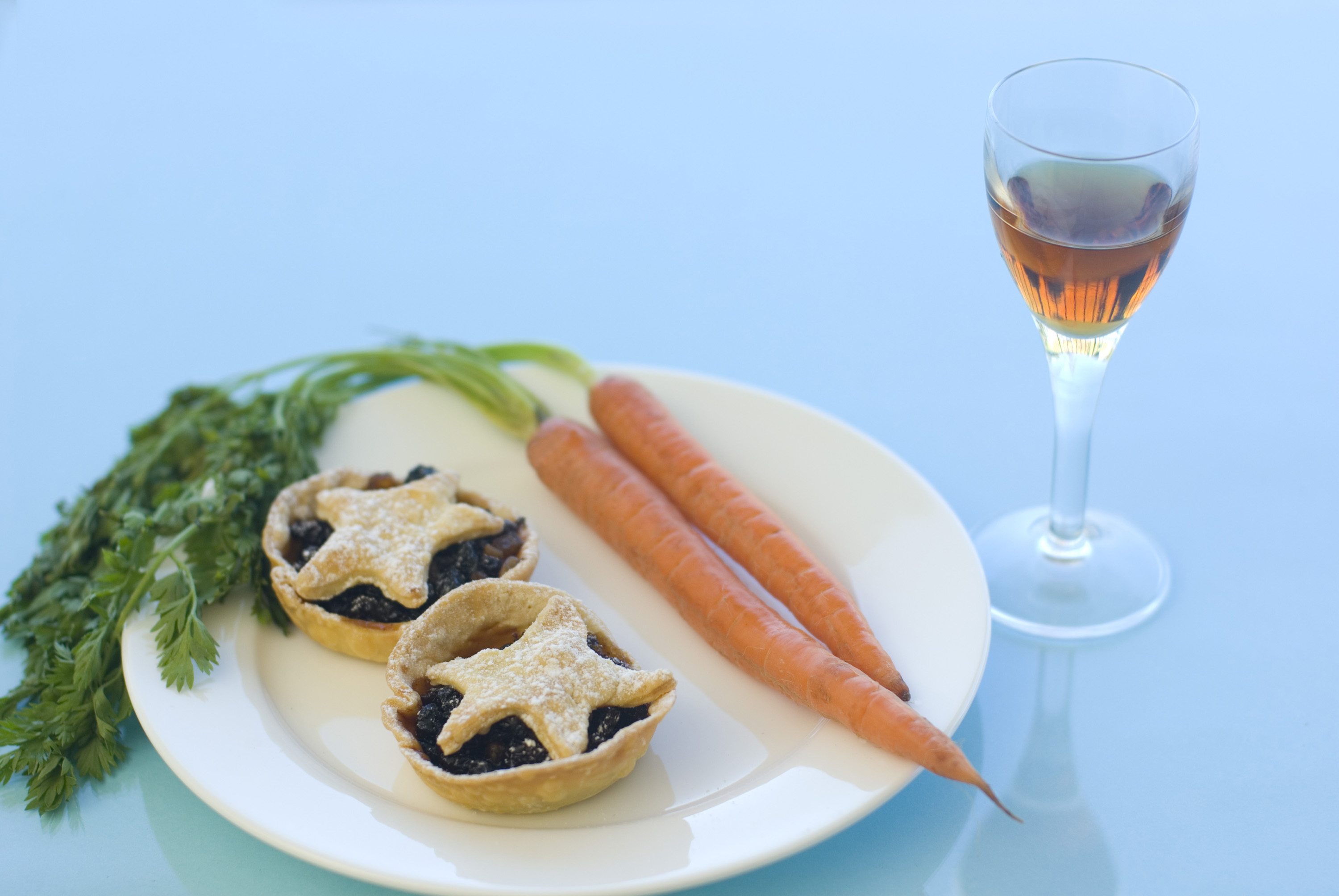 a place of mince pies and sherry for santa plus a carrot left for rudolph