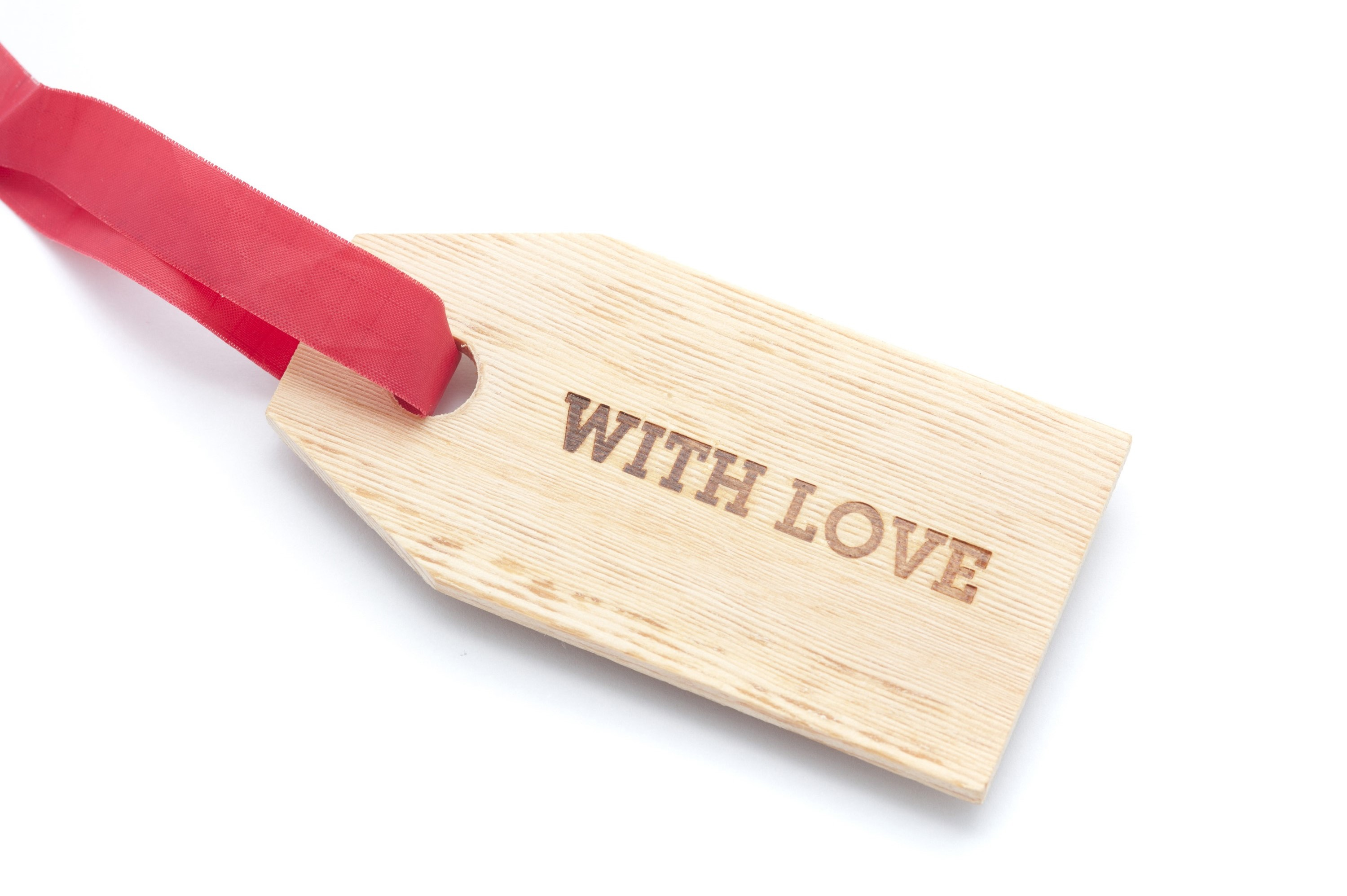 With Love gift tag with a wood grain texture and a festive red ribbon attached over a white background