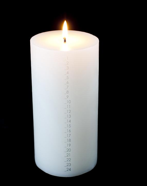 large white advent candle numberd to countdown to christmas eve
